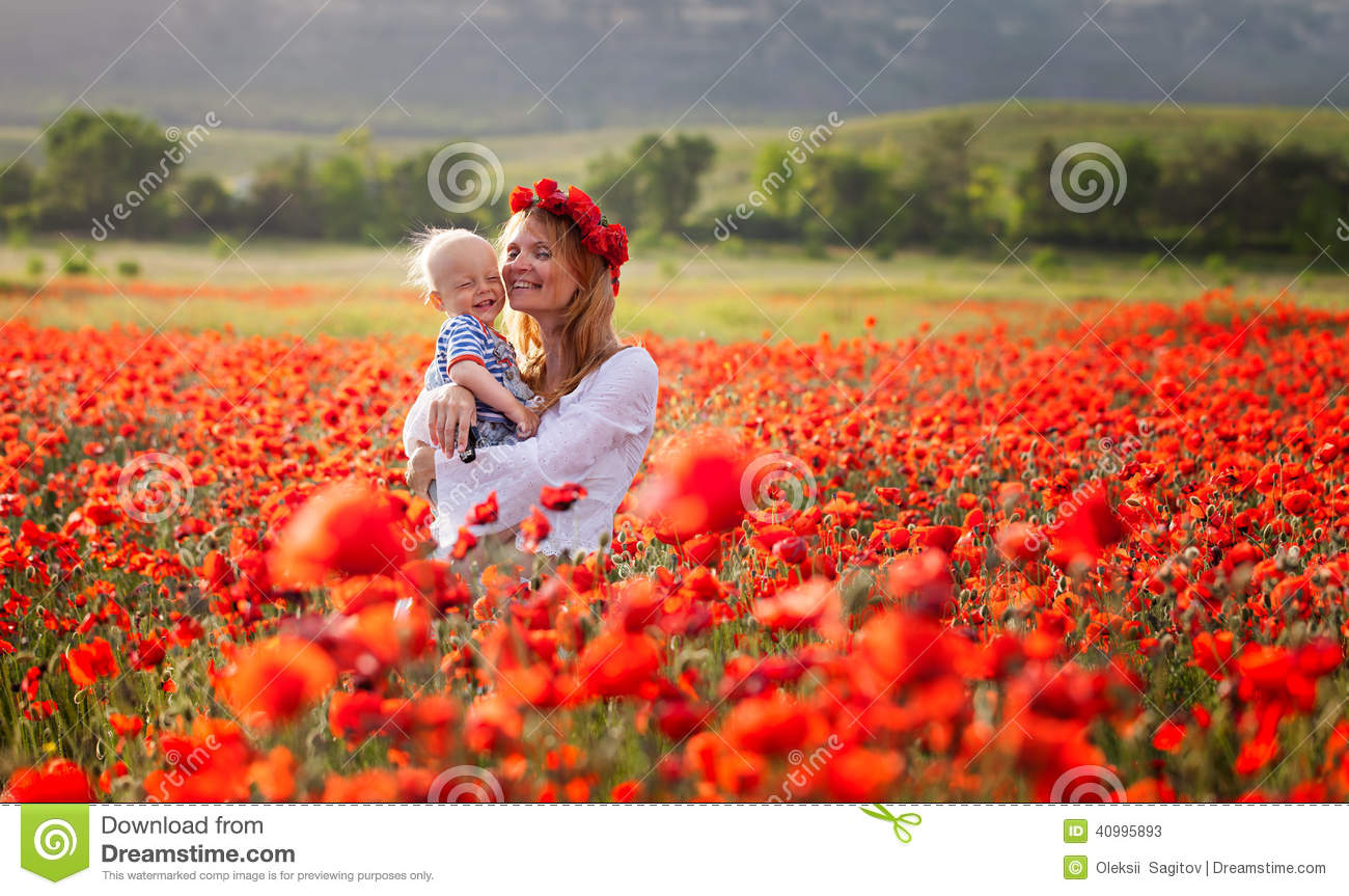 Download Woman With Baby In A Field Of Red Poppies Stock Image - Image of childhood, baby: 40995893