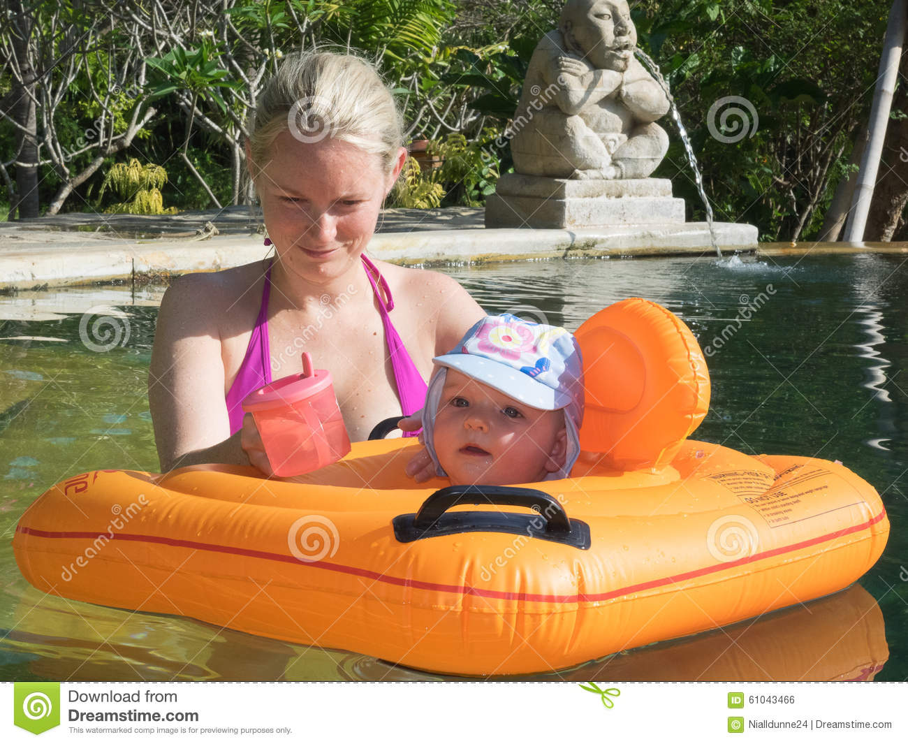 Woman And Baby In A Swimming Pool Bali Stock Photo Image 61043466