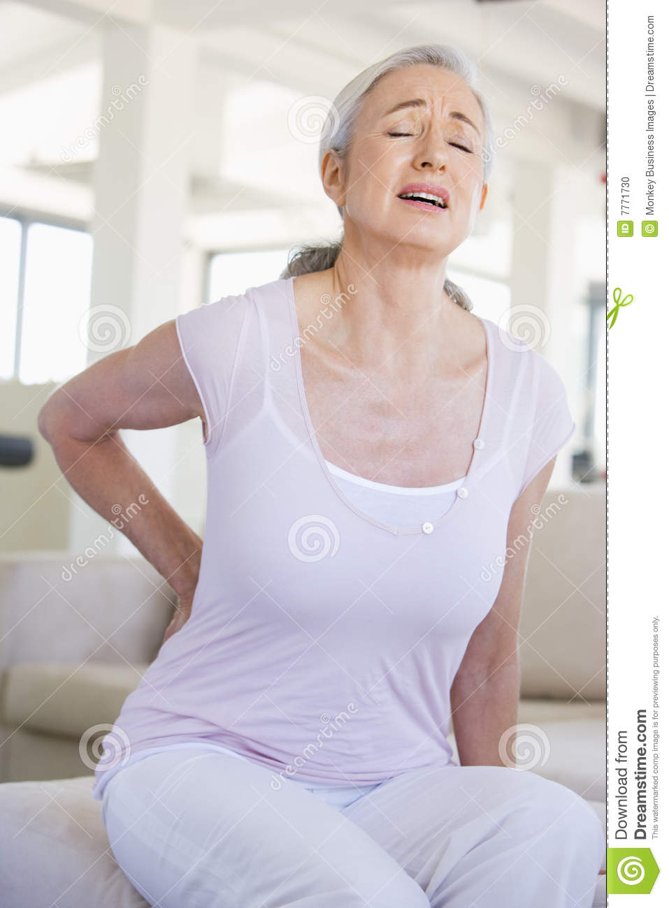 Beautiful Young Woman With Back Pain Stock Photo - Image