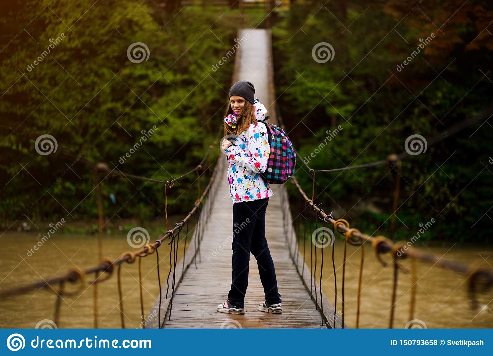 Woman with backpack hiking Lifestyle adventure concept forest and cross river in forest active vacations