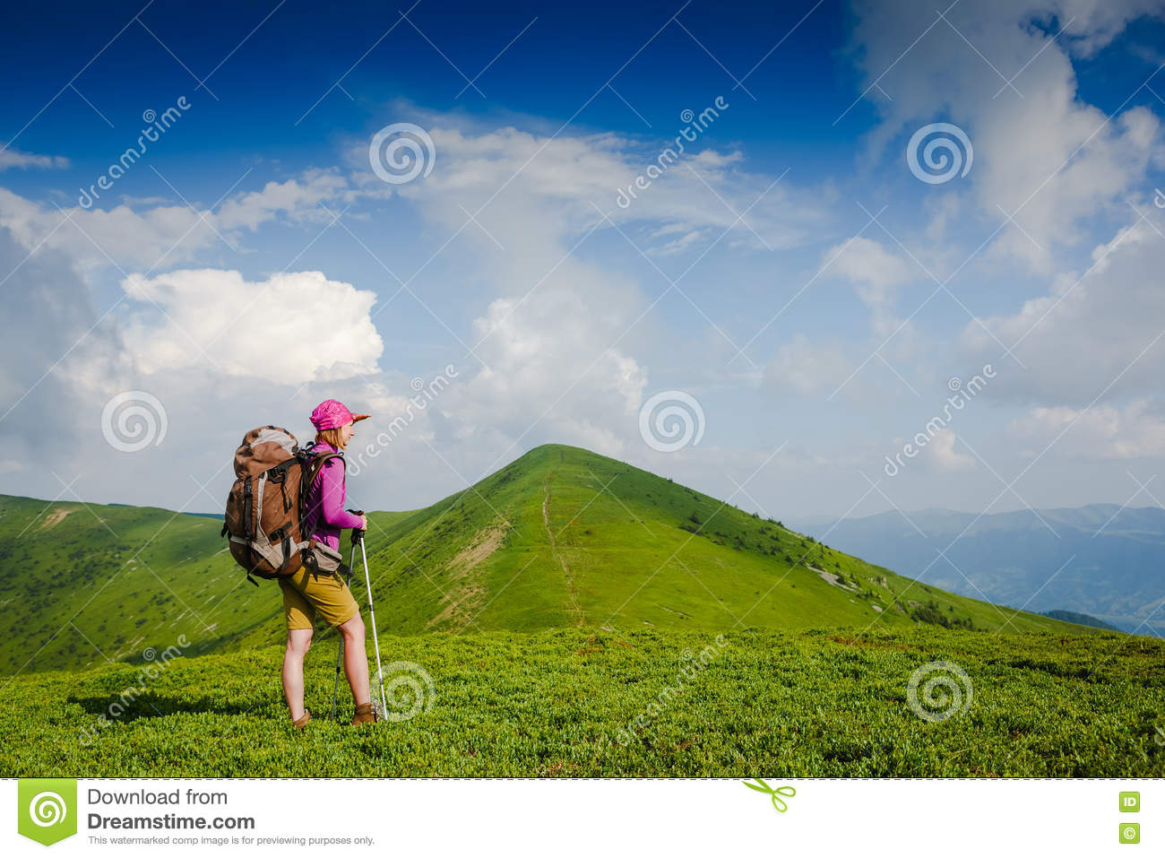 Woman backpacker in the mountains enjoy the view