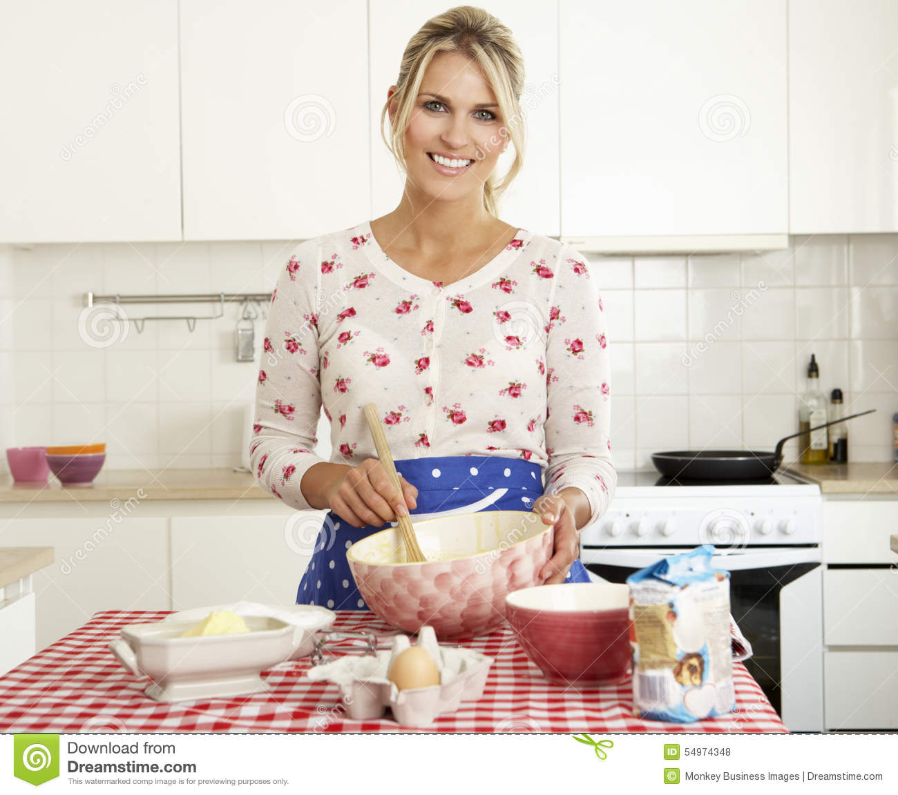 Women Kitchen: Woman Baking In Kitchen Stock Photo