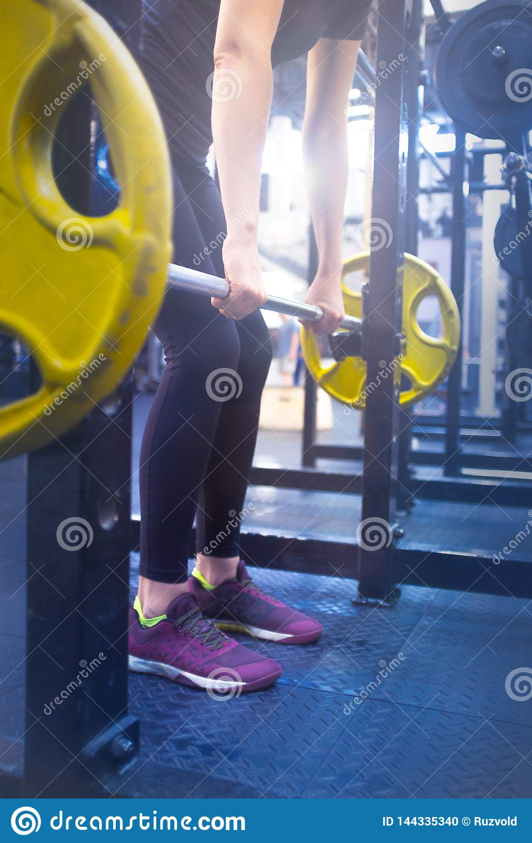 Woman With A Barbell Doing Exercises In The Gym Stock Photo Image Of Athletic Machine 144335340