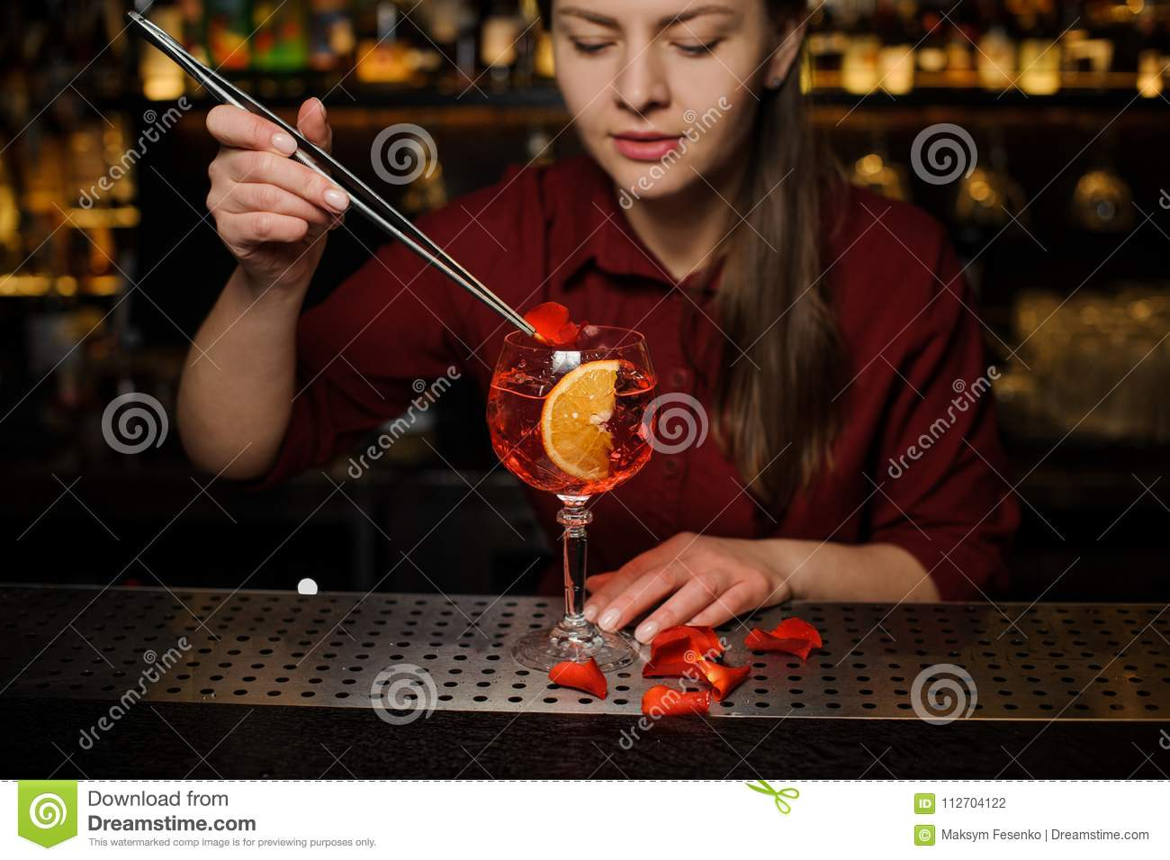 Woman Barman Decorating A Glass Of Aperol Syringe Cocktail With