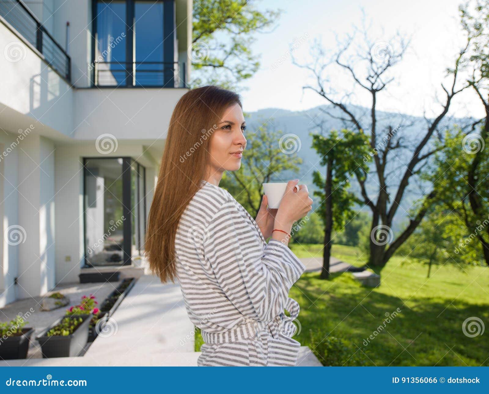 Woman In A Bathrobe Enjoying Morning Coffee Stock Photo ...