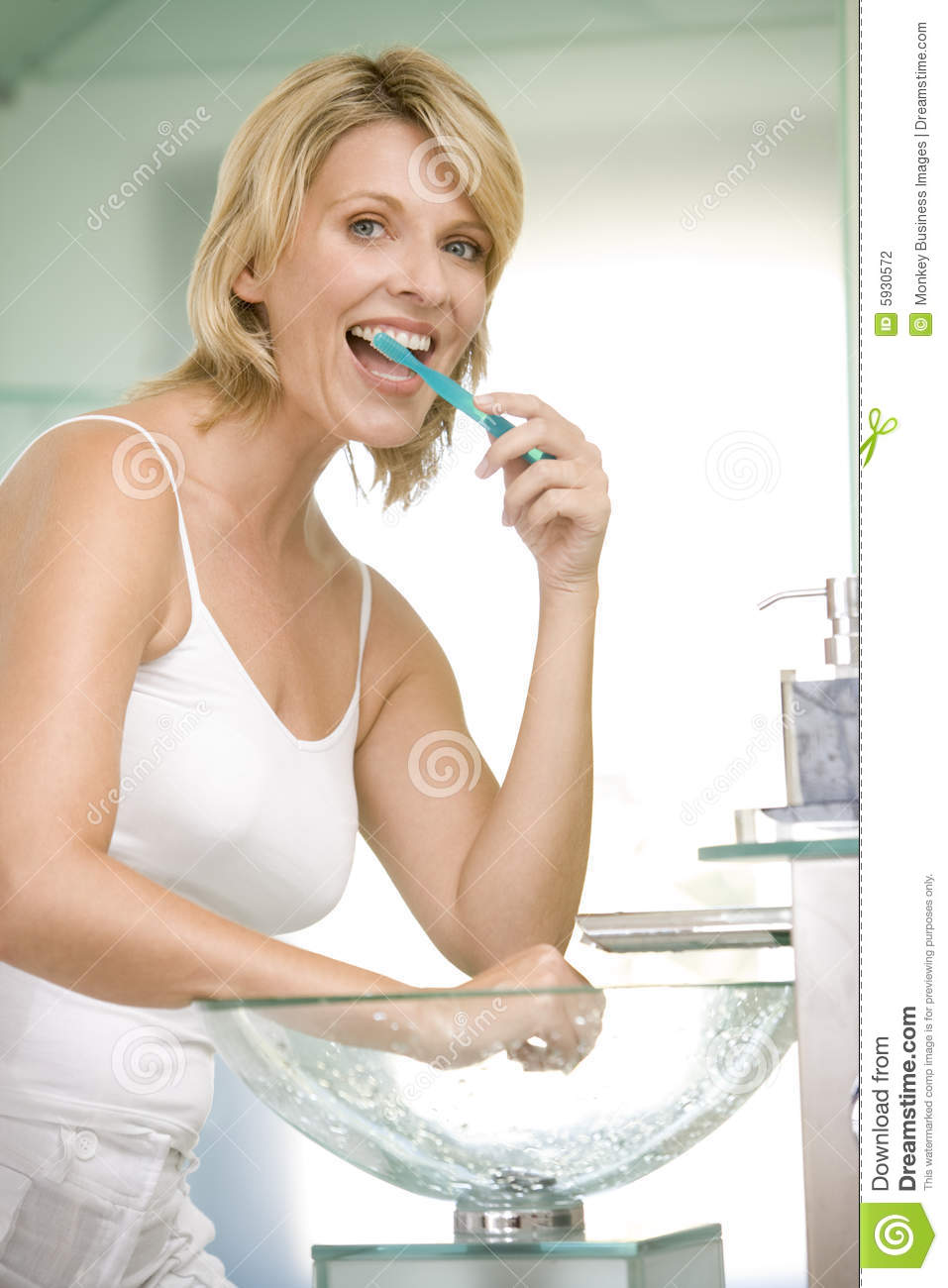 Woman In Bathroom Brushing Teeth Stock Photography - Image ...