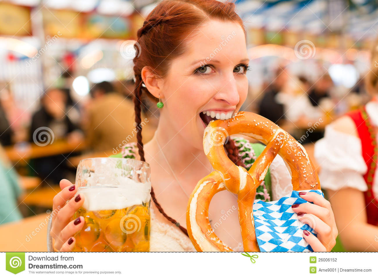 Woman with Bavarian clothes or dirndl in beer tent