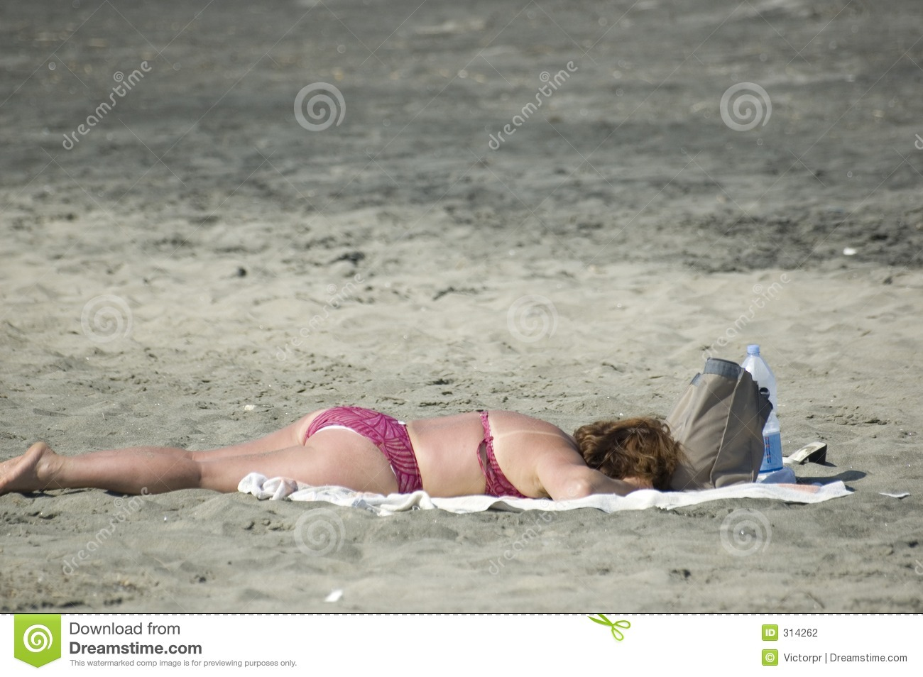 Chubby mature woman at the beach