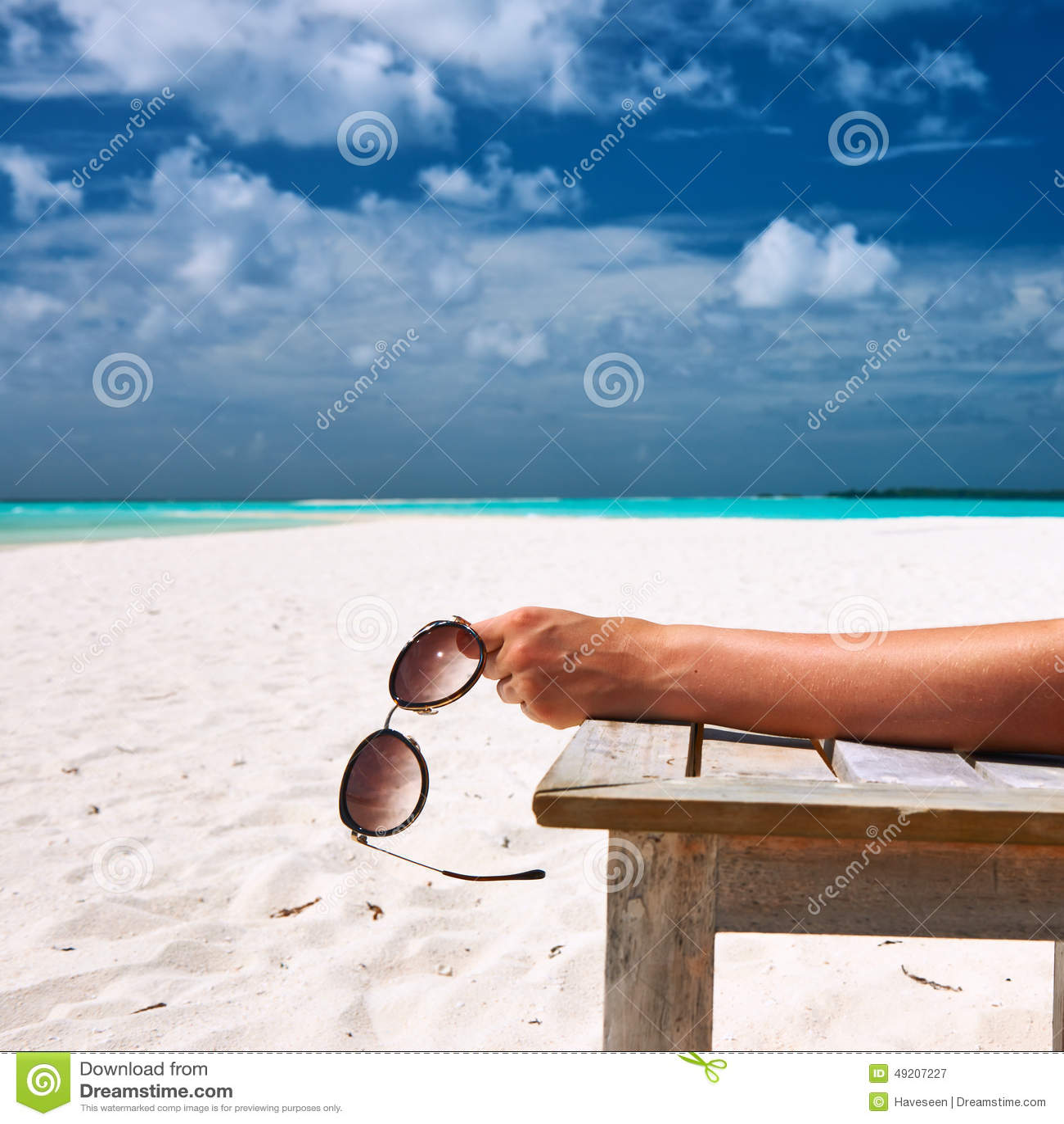 Woman At Beach Holding Sunglasses Stock Image