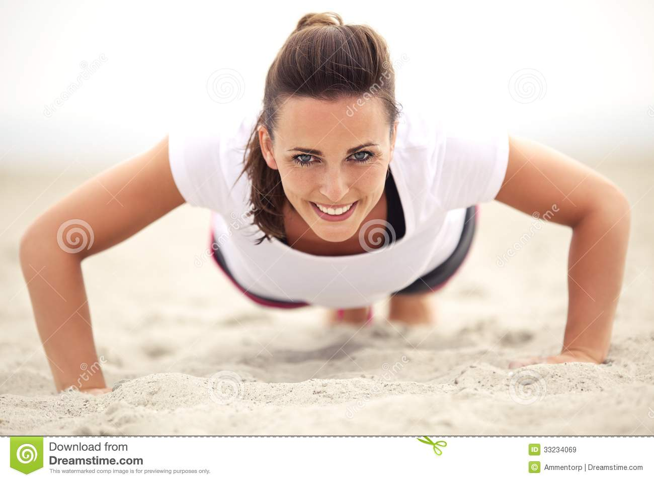 Woman On The Beach Smiling While Doing Push Up Royalty ...