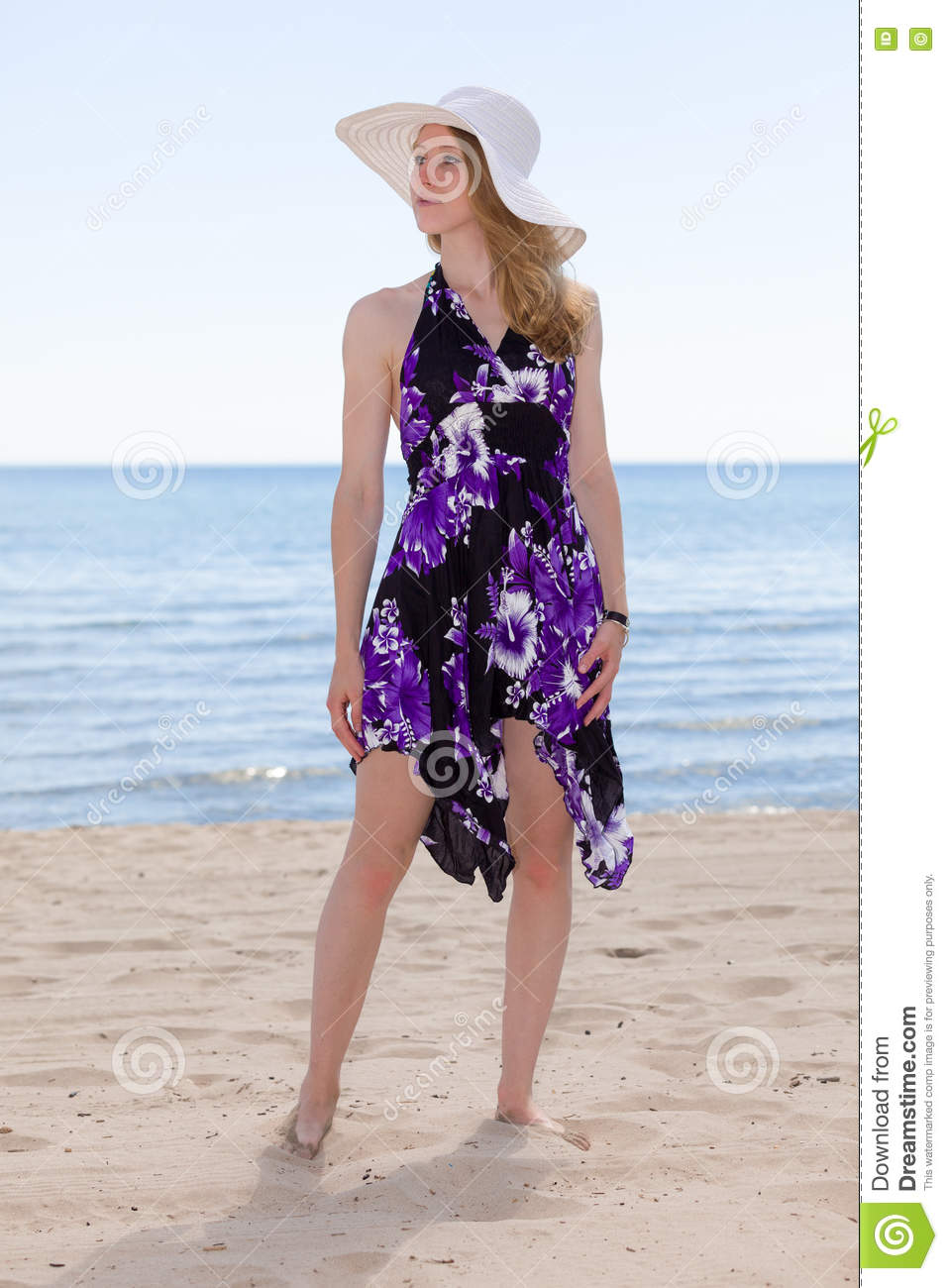 b65dbbccc5 Woman At The Beach Wearing A Sundress Stock Photo - Image of leisure ...