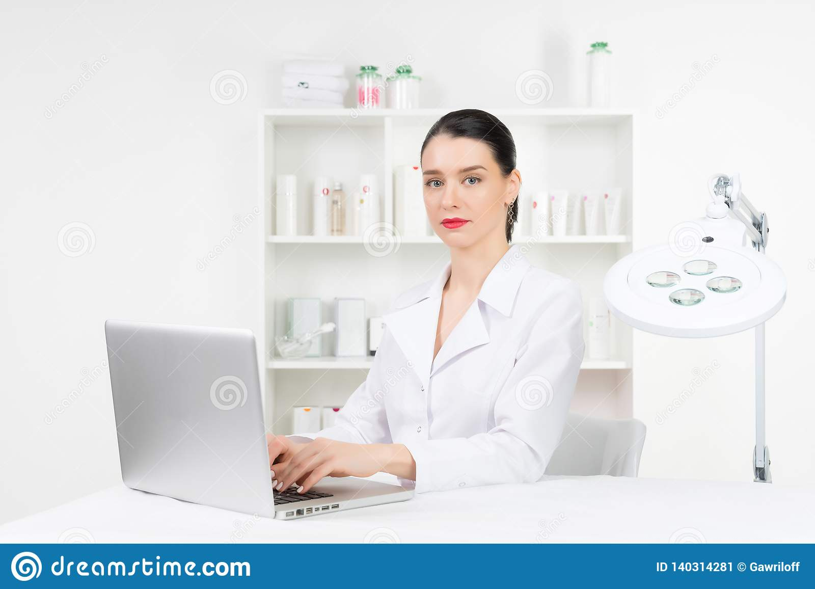 Woman beautician doctor at work in spa center. Portrait of a young female professional cosmetologist. Female employee in