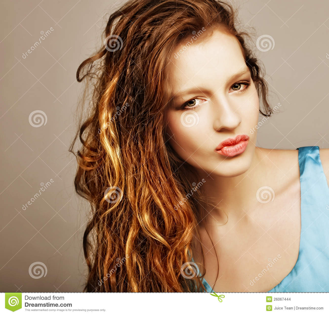 Woman with beautiful long blond curly hairs