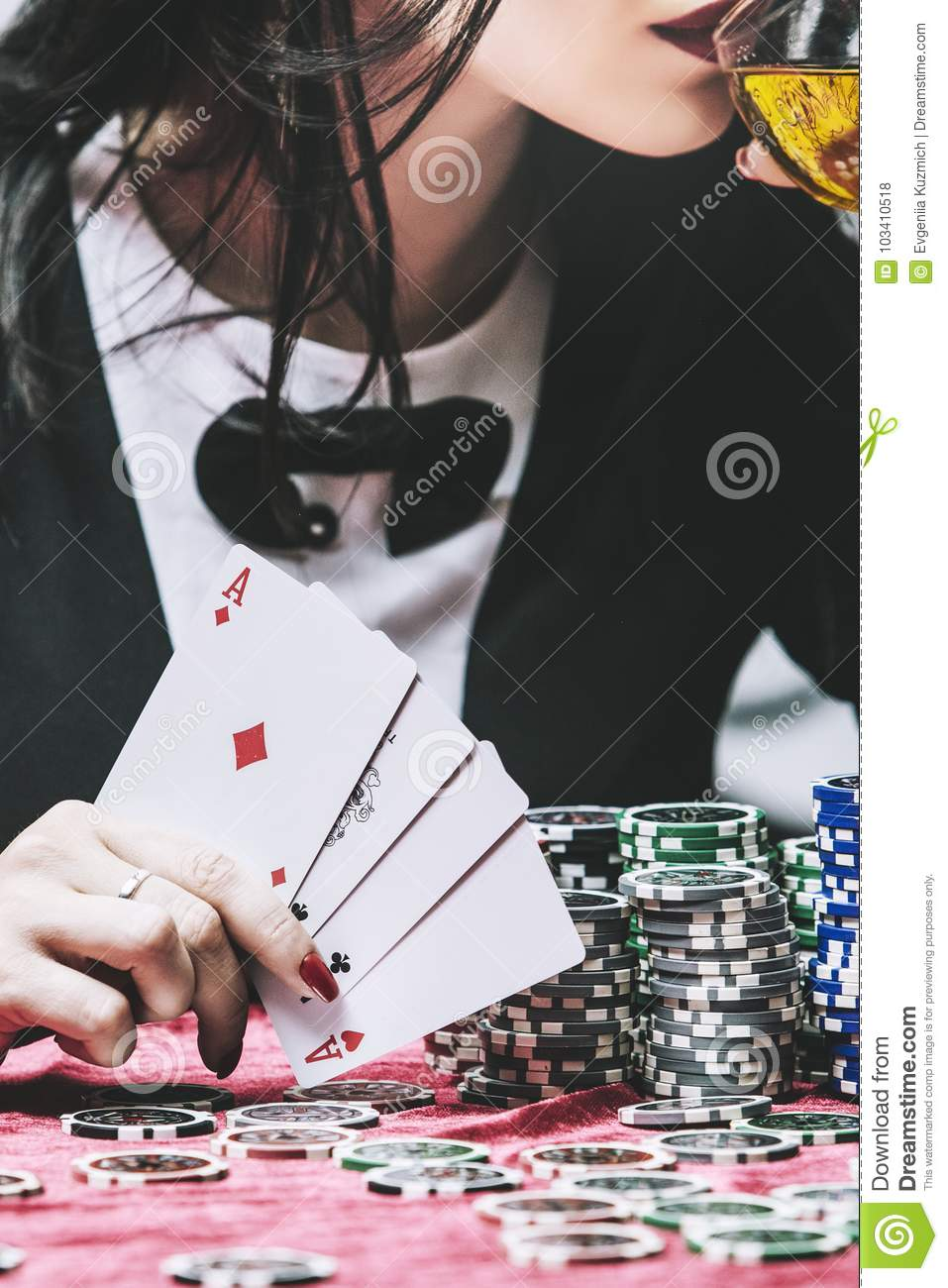Woman beautiful young successful gambling in a casino at a table