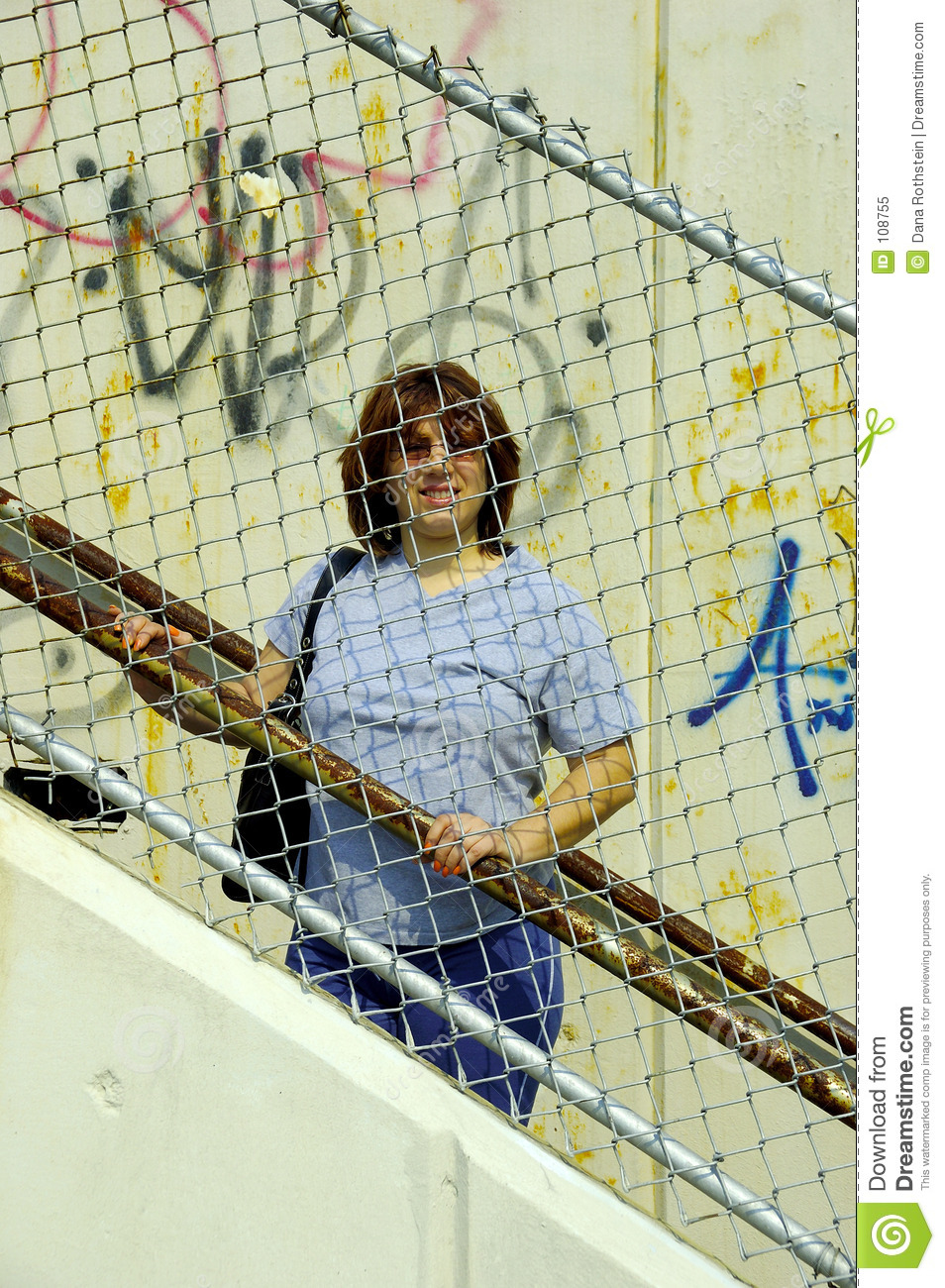 Woman Behind a Fence
