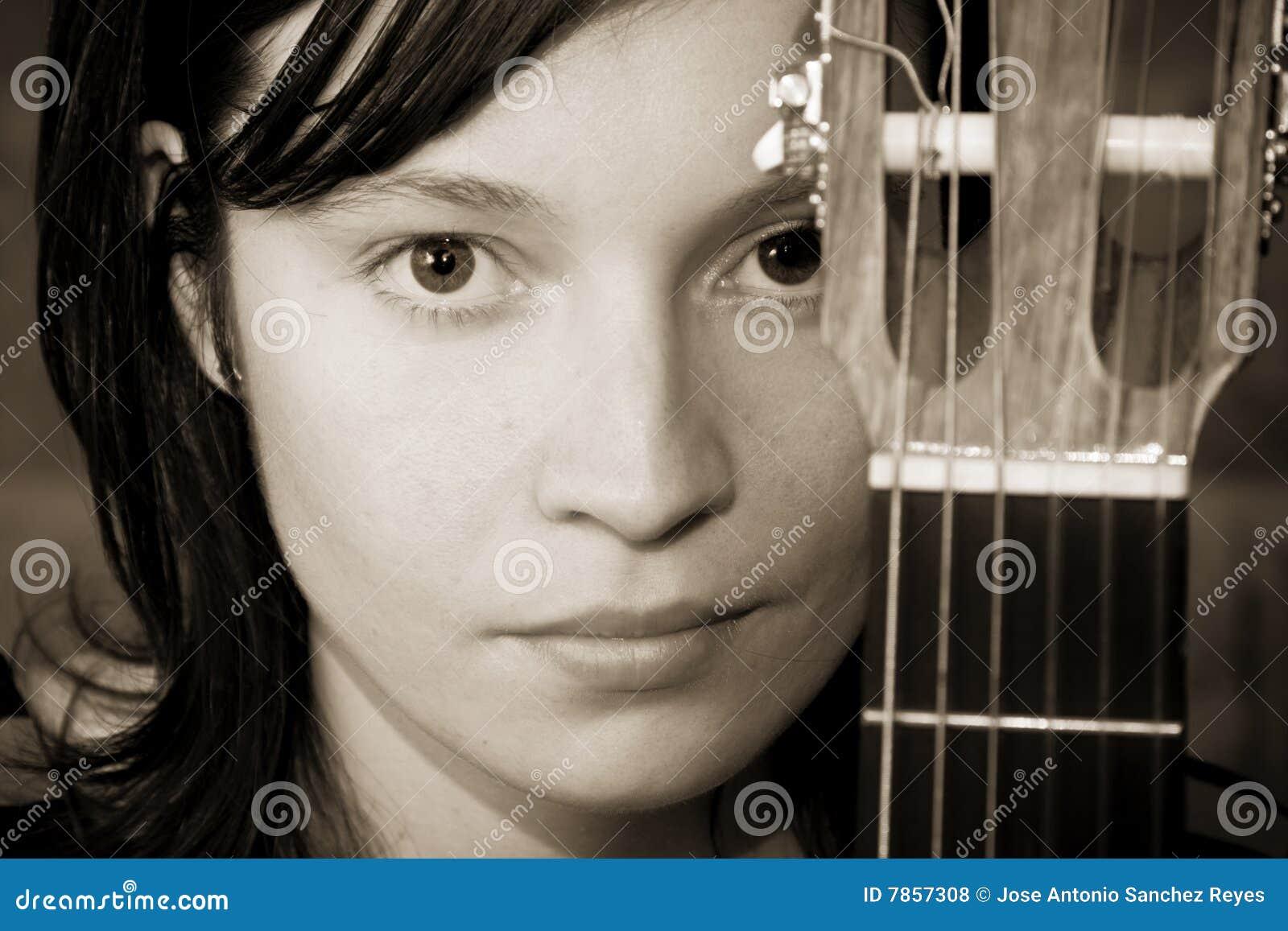 Woman behind fretboard