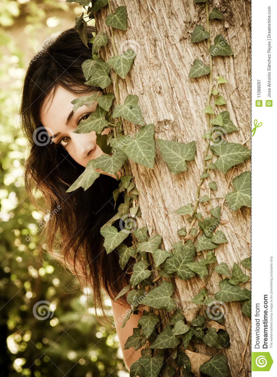 Woman behind leaves