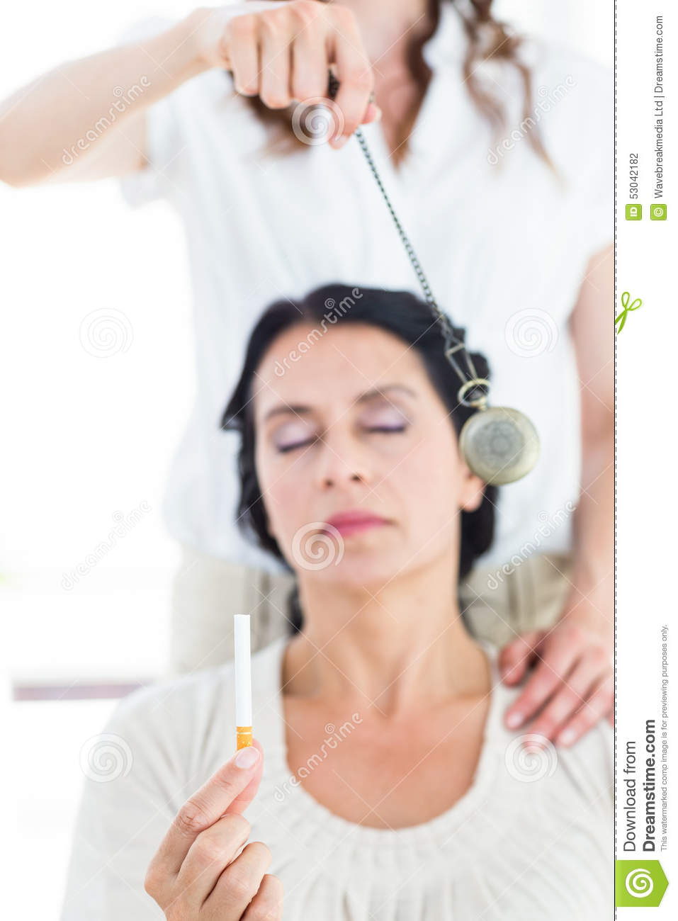 Woman being hypnotized to quit smoking
