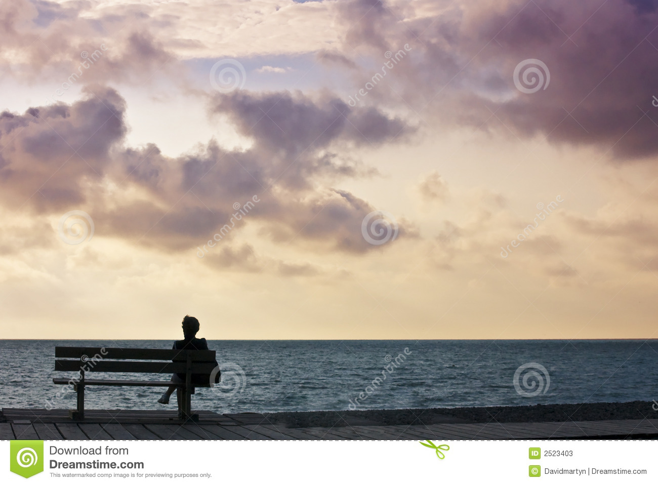 Girl Sitting Alone On Bench Woman sitting on bench looking