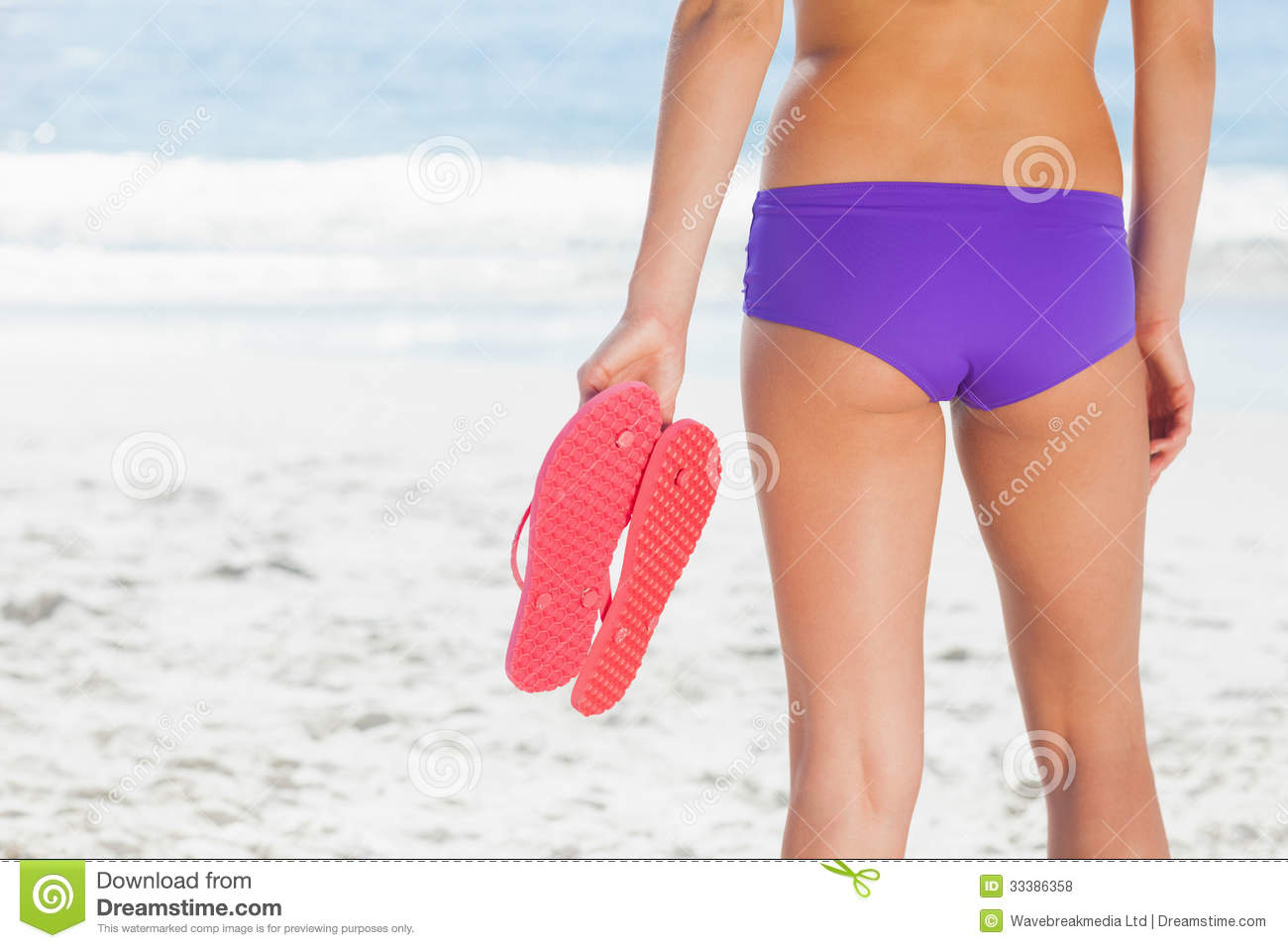 468b7ee13398ae Woman In Bikini On Beach Holding Flip Flops Stock Photo - Image of ...