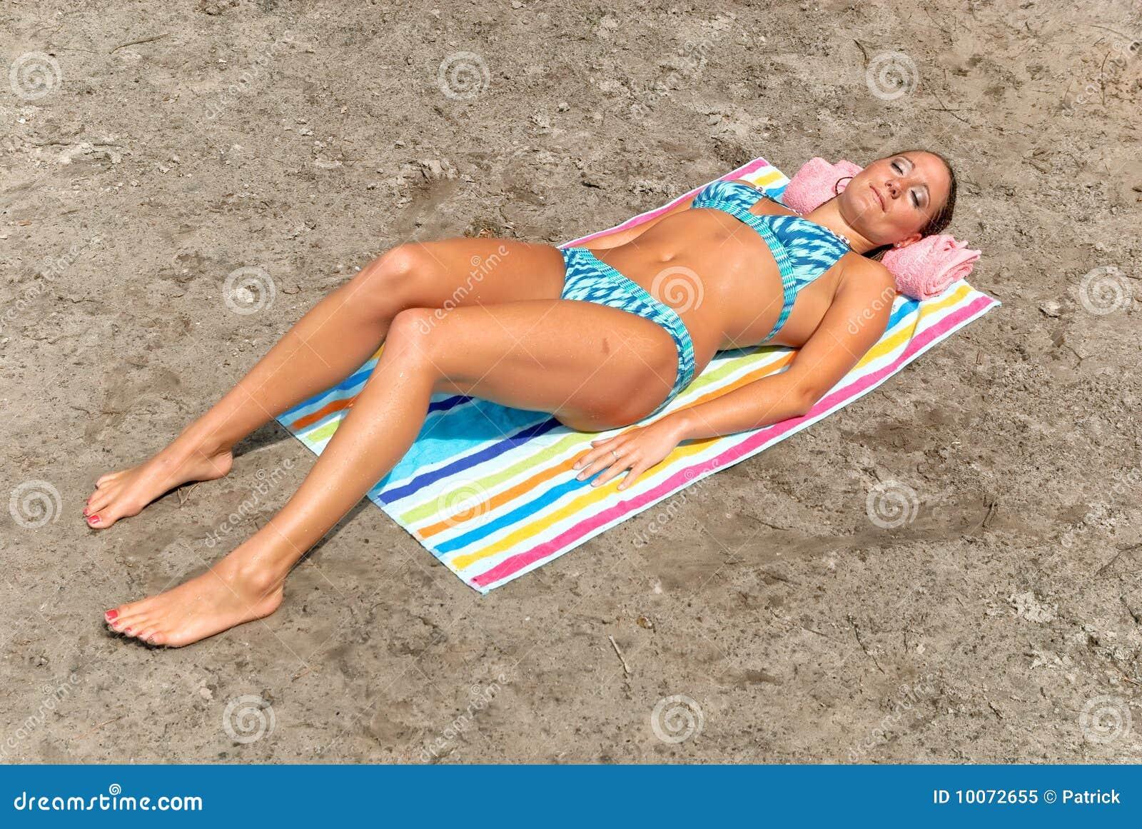 Teen beach sunbathing