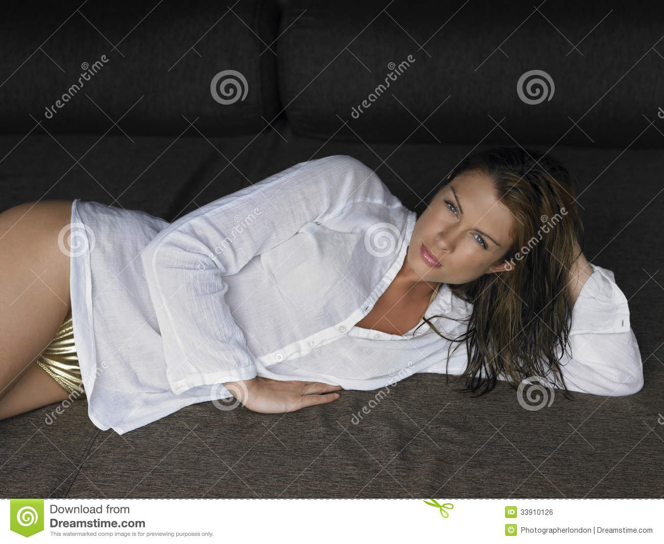 Woman in bikini and shirt lying in bed royalty free stock for Sexy bed photos