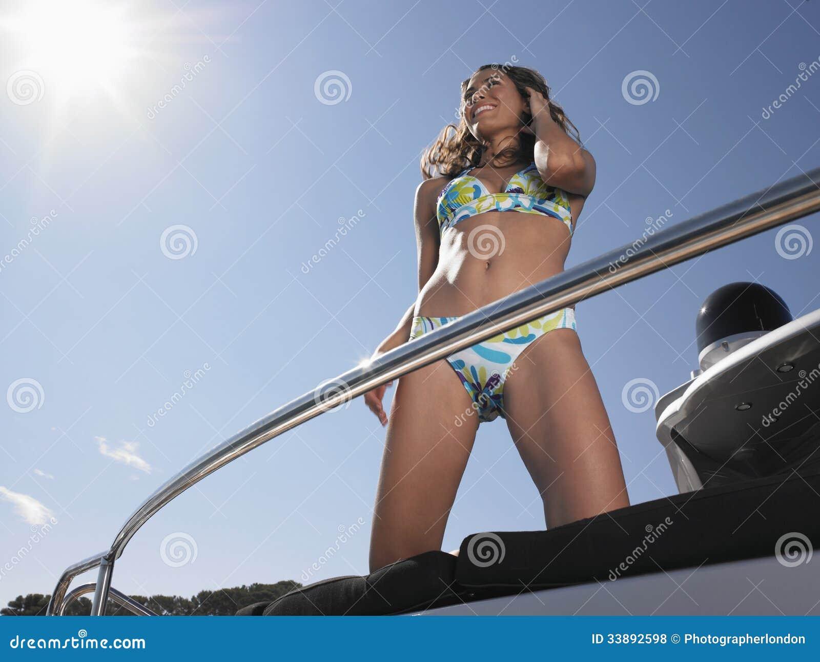 Woman In Bikini Standing On Yacht Royalty Free Stock ...