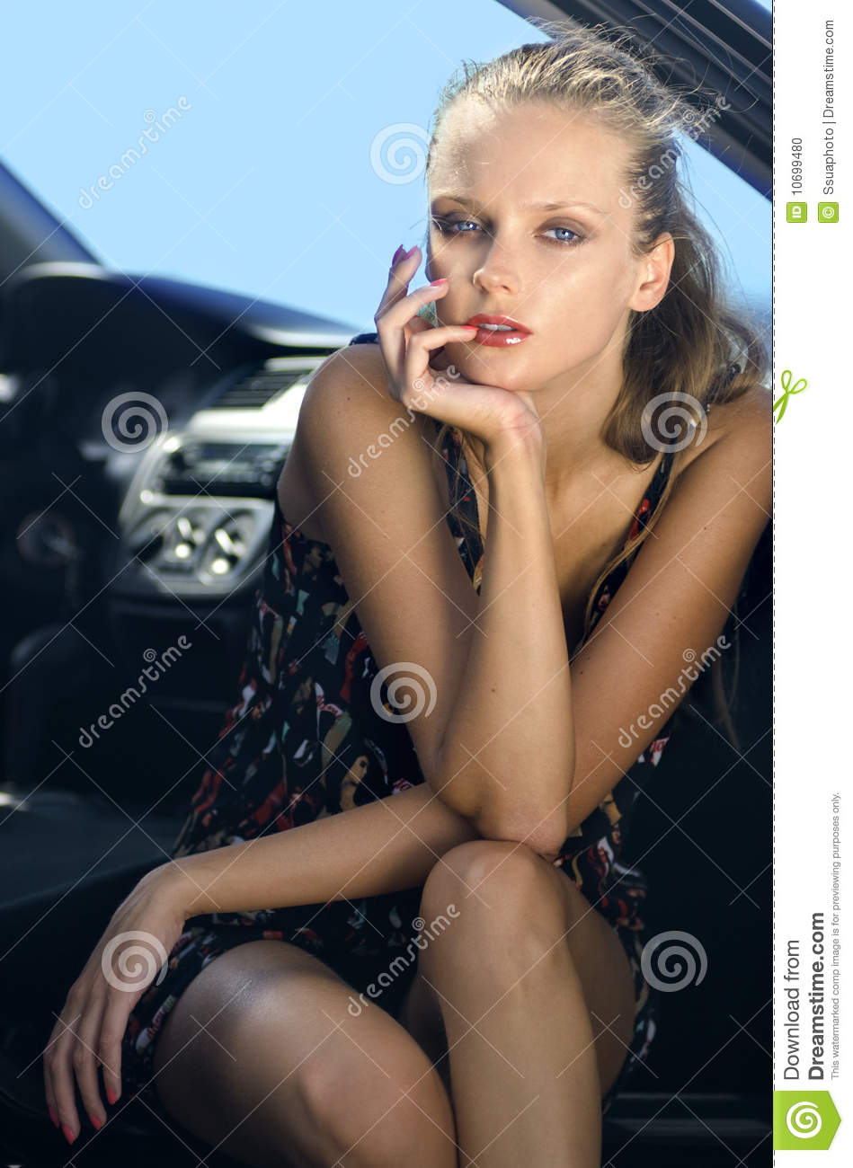 Woman in the black car