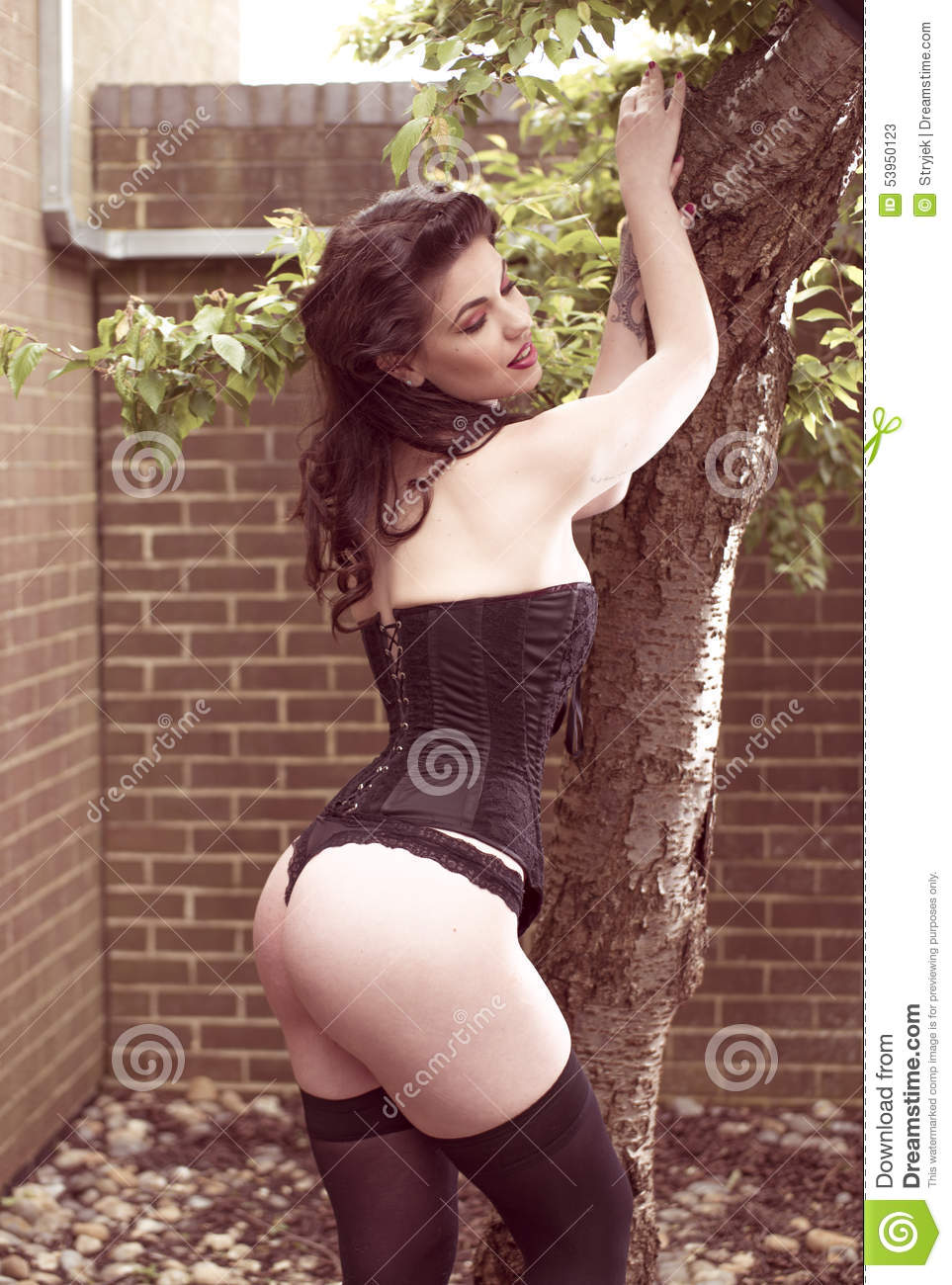 Brunette wearing black thong