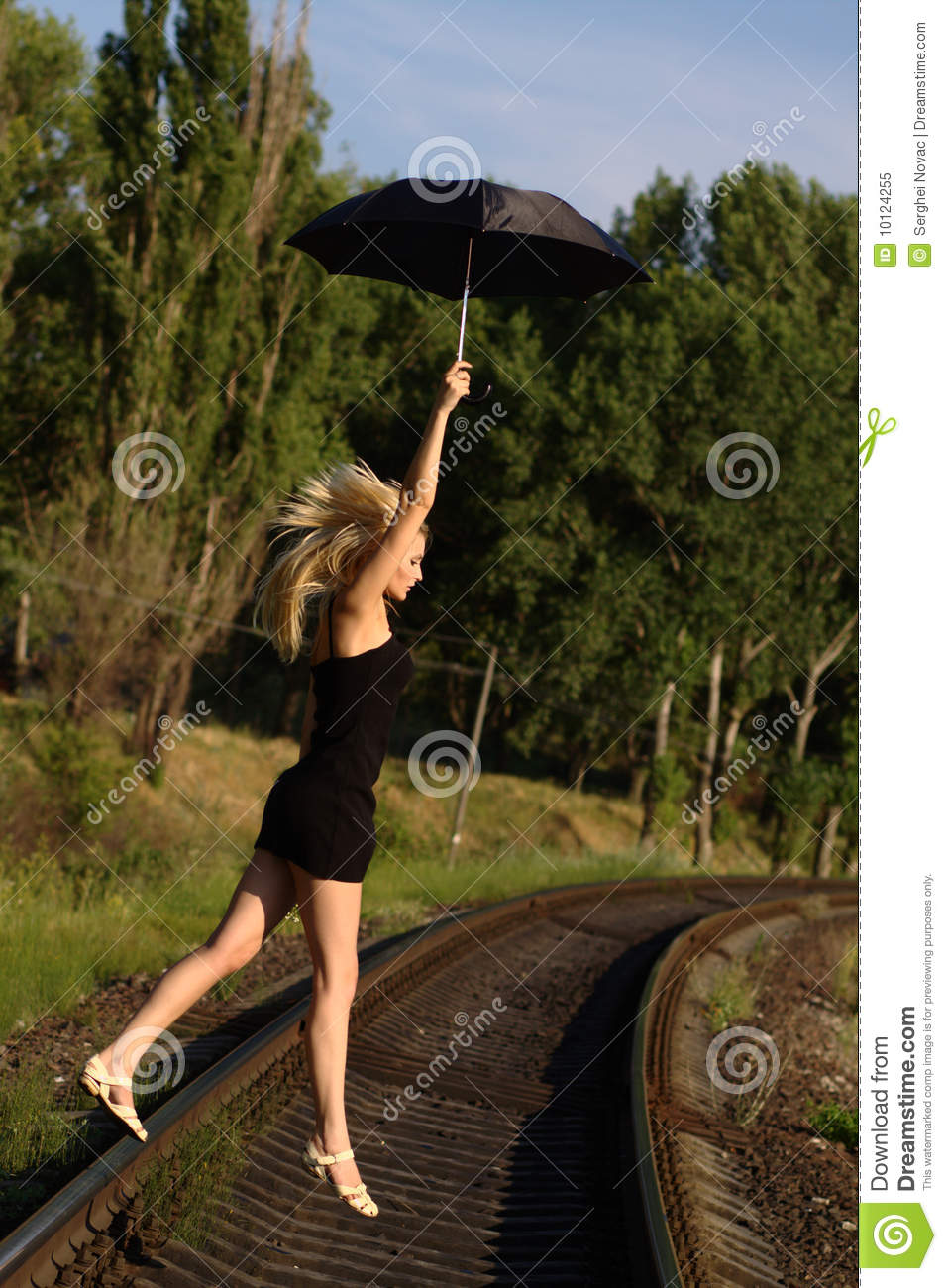 Woman In Black Dress Flying On An Umbrella Stock Image ...