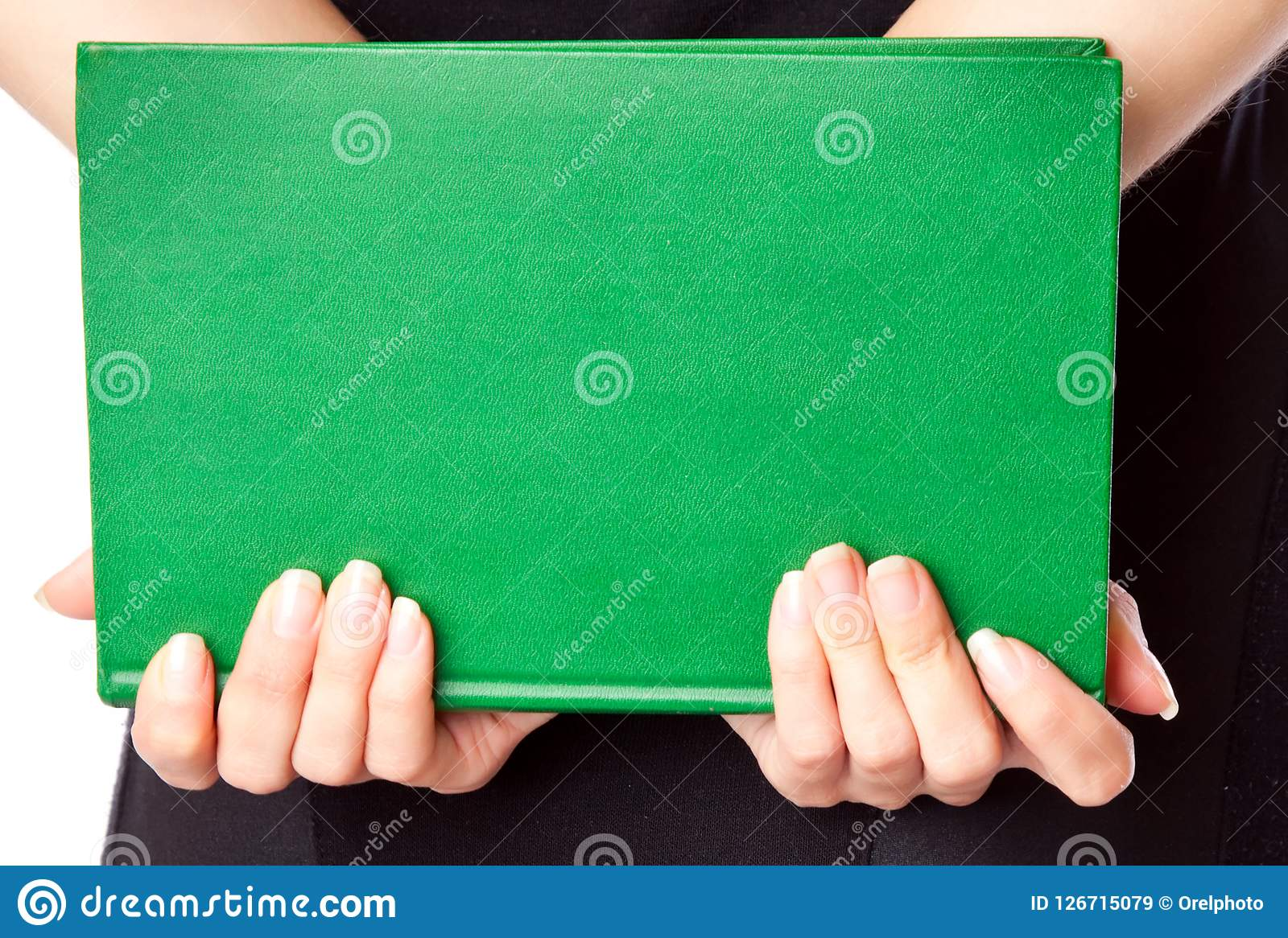 Woman in black dress holding book. Woman in black dress holding green book Royalty Free Stock Images