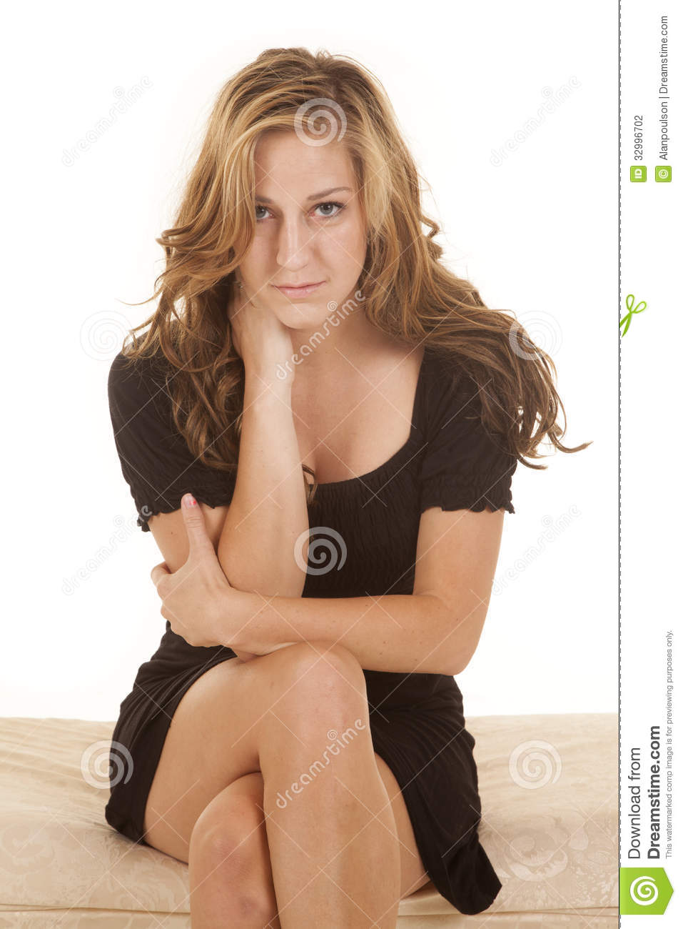 Woman Black Dress Sit Facing Serious Cross Legs Stock