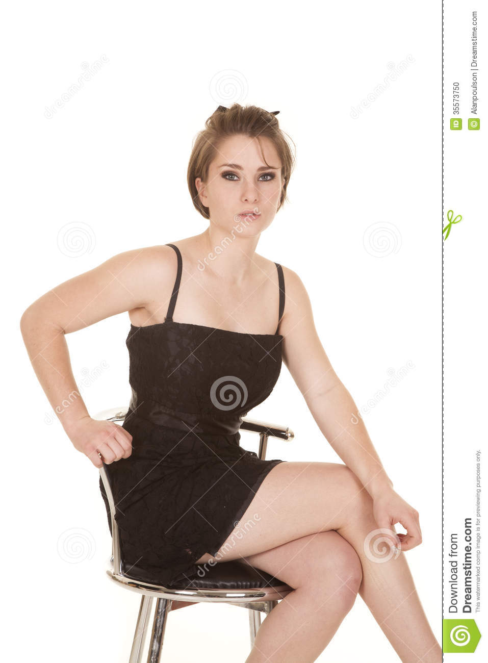 Woman Black Dress Sit Serious Hand Chair Stock Photo