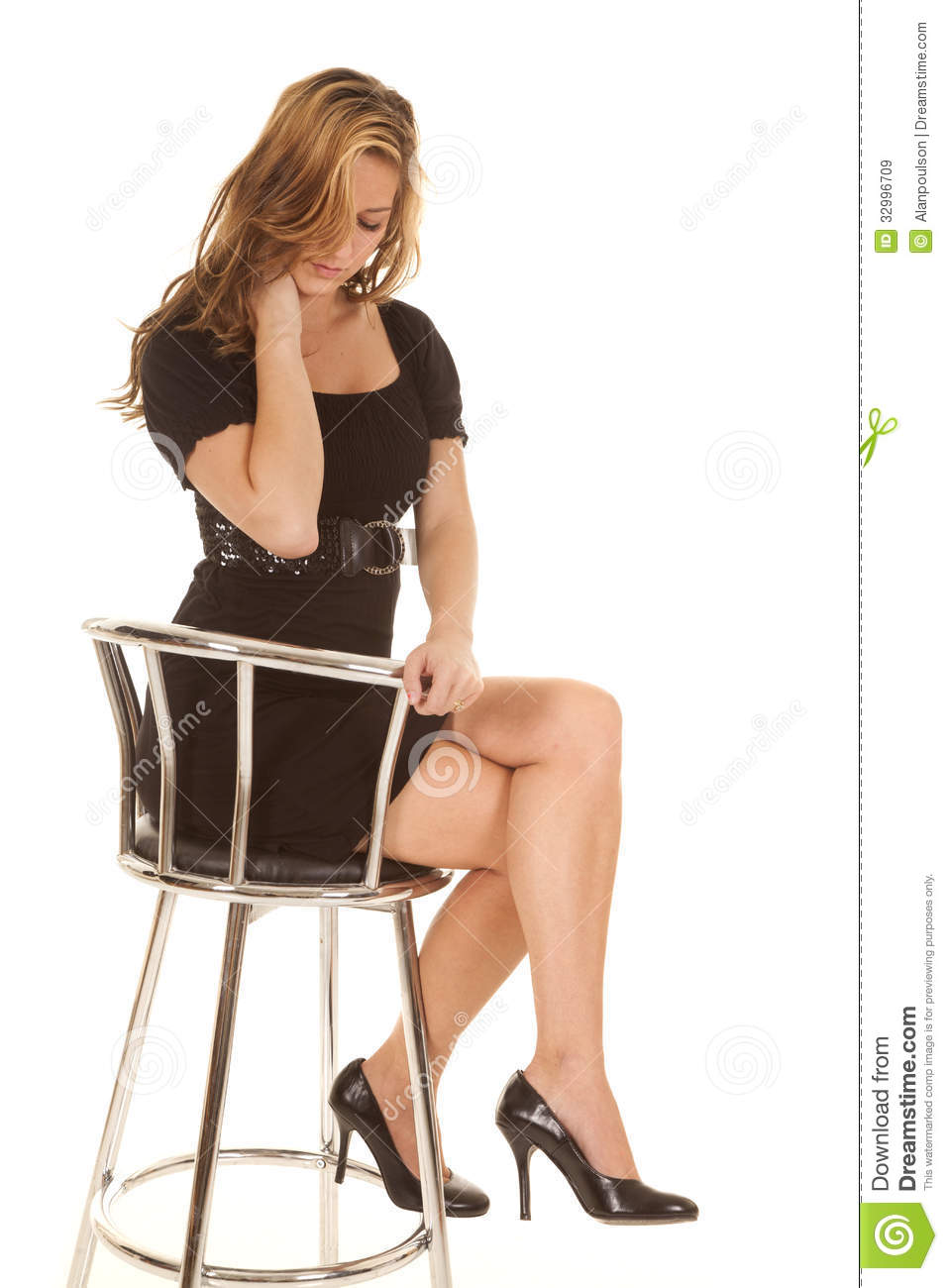 Woman In Black Dress Sitting On Chair Stock Image Image