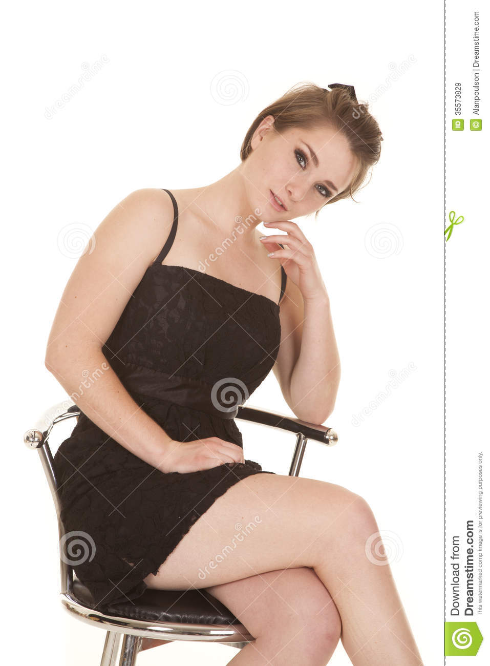 Woman In A Black Dress Sitting Hand On Chin Stock Image