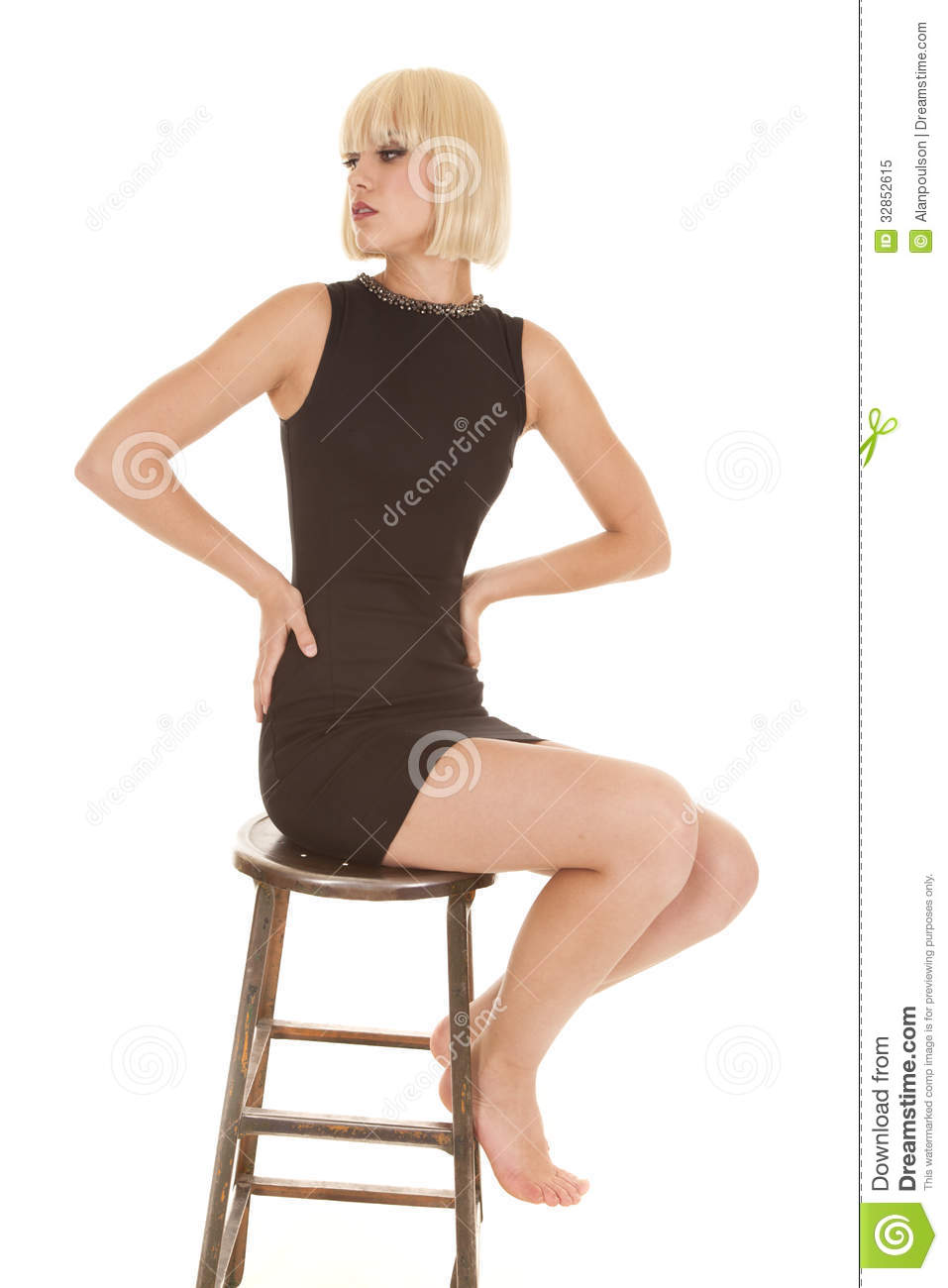 Woman In Black Dress On Stool Look Back Royalty Free Stock