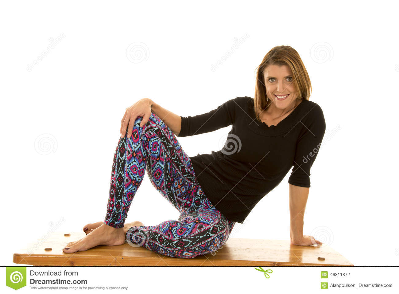 Woman Black Top And Leggins Sit Knees Out Stock Photo