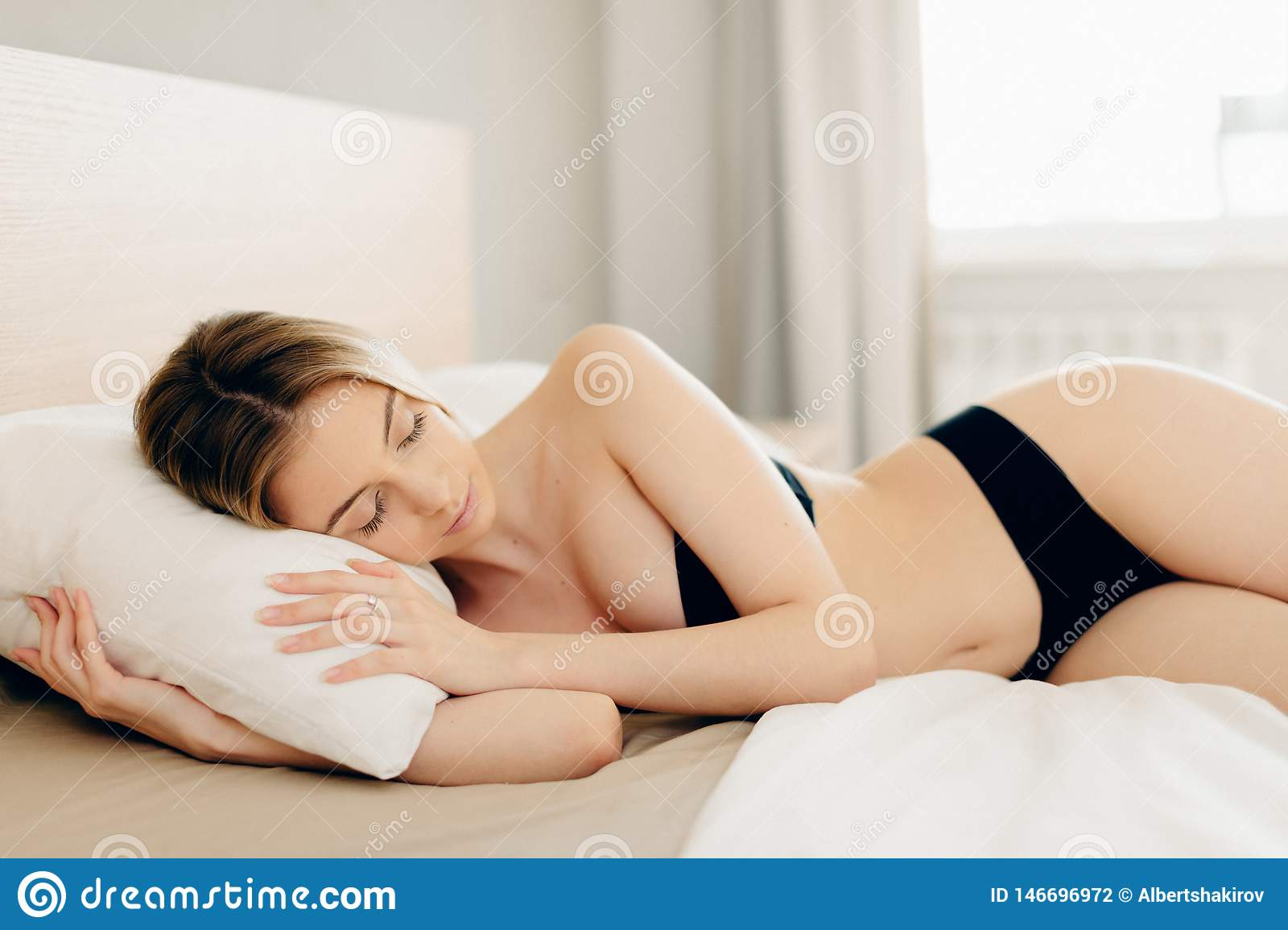 Woman In Black Underwear Sleeping In Bed In Seductive Pose Without