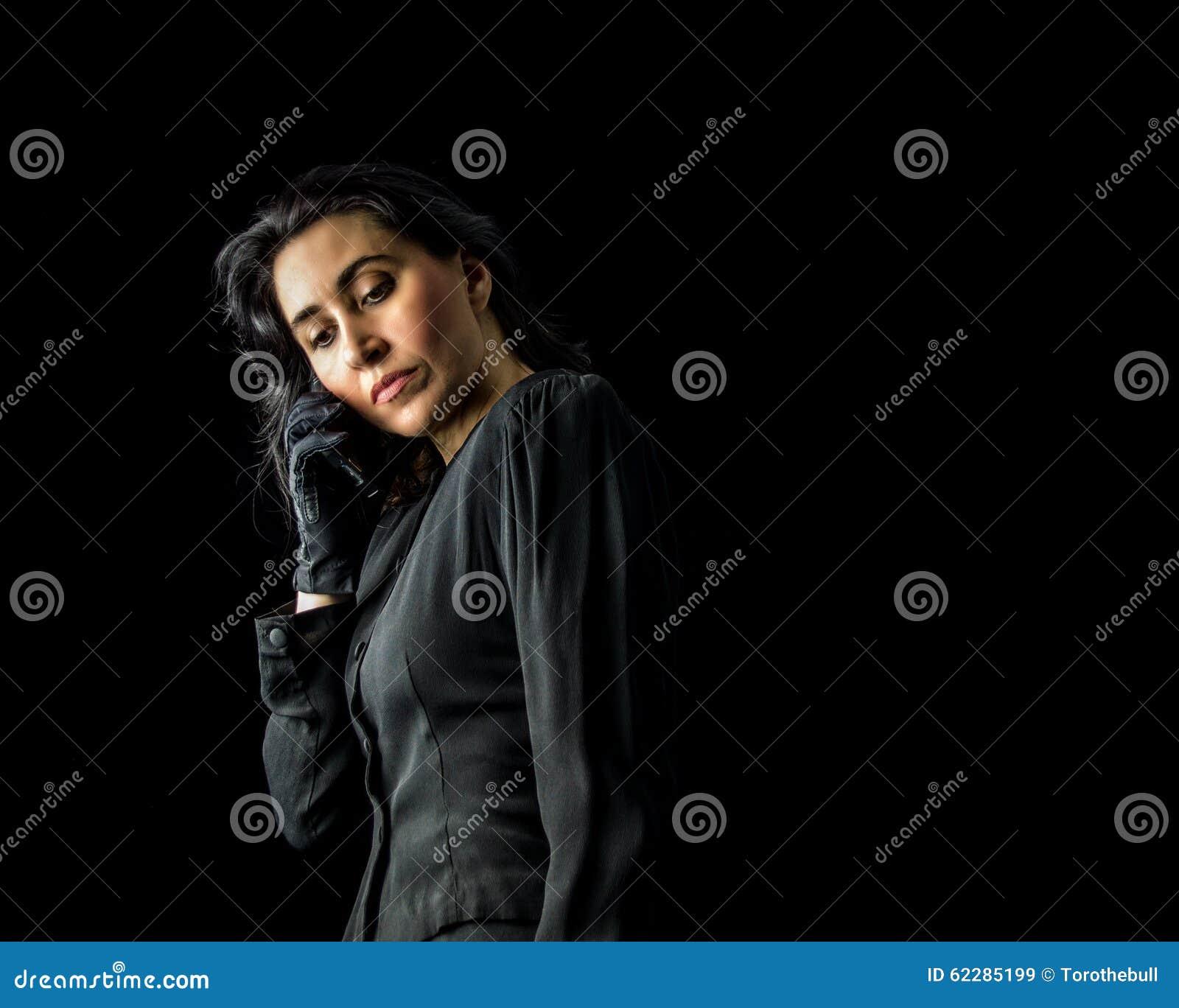 ec61b6eba Woman In Black Using Cell Phone Stock Image - Image of gloves, dress ...