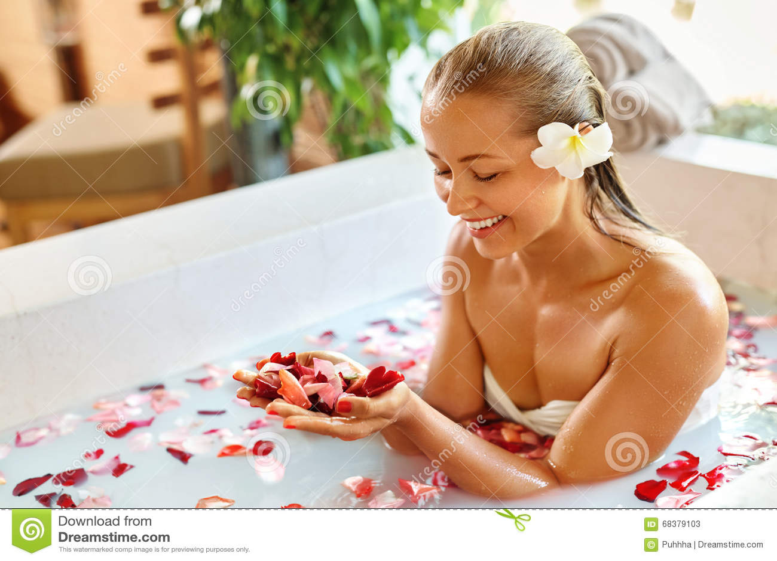 434aaaa219603 woman-body-care-spa-rose-flower-bath -treatment-aromatherapy-petals-close-up-sexy-blonde-female-bikini -taking-resort-68379103.jpg