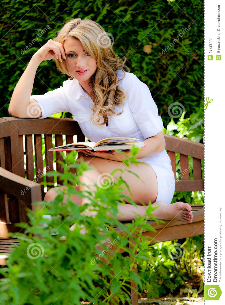 Woman At Book Reading In The Garden Stock Image
