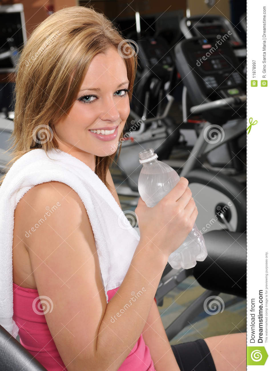 woman with bottled water at the gym royalty free stock
