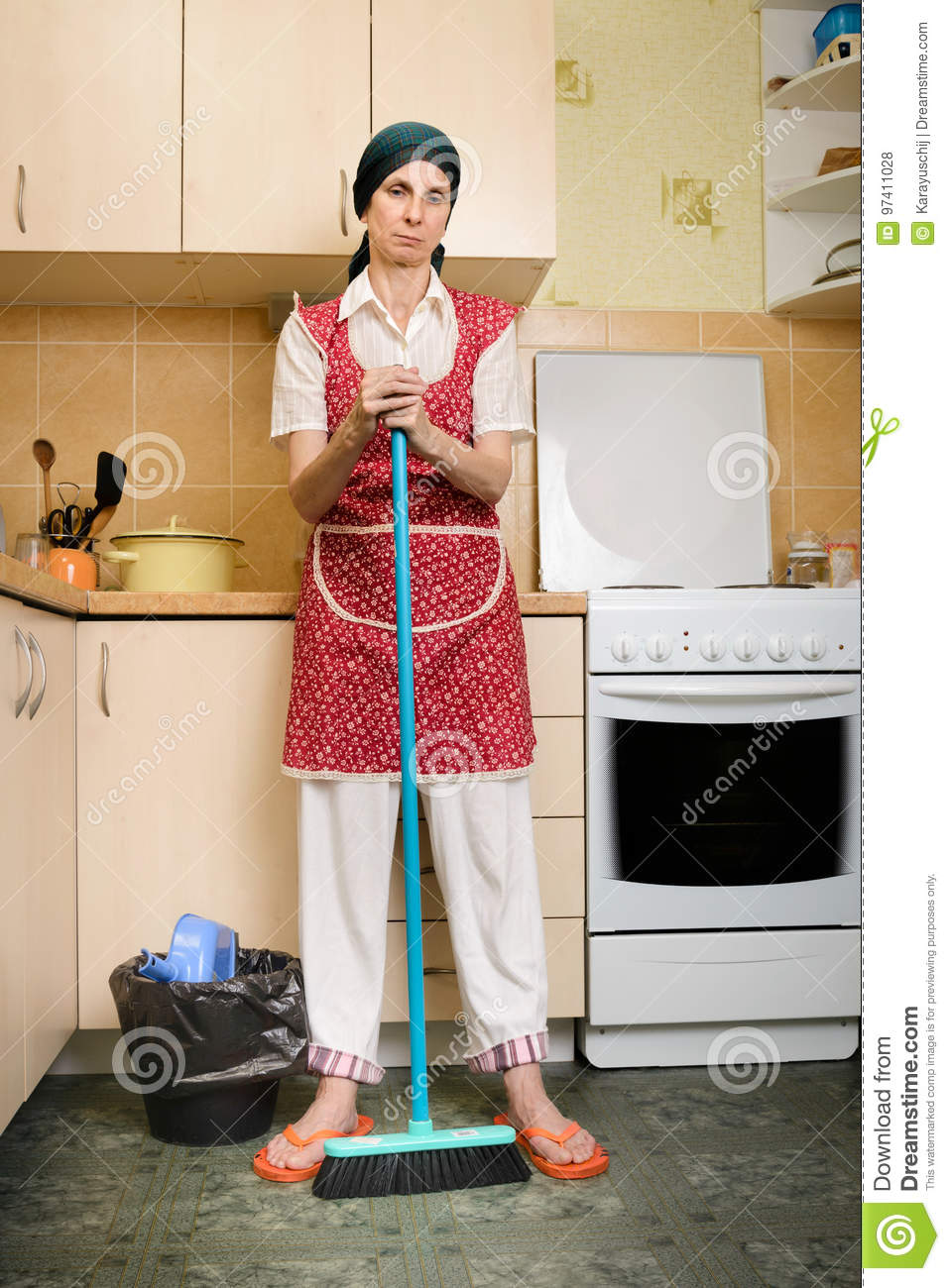 woman with a broom in the kitchen stock photo - image of