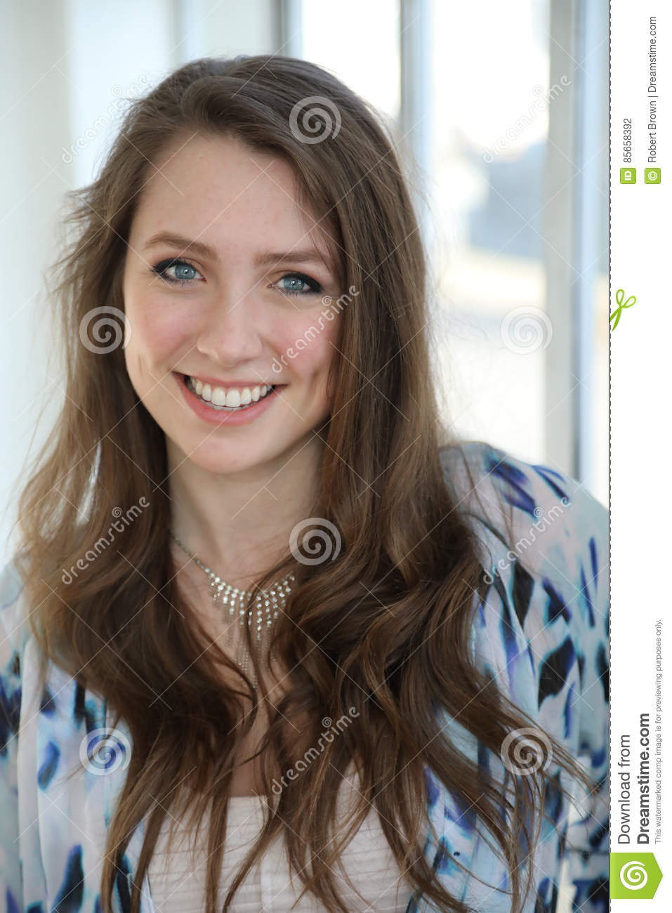 Woman With Brown Hair And Beautiful Blue Eyes Stock Photo
