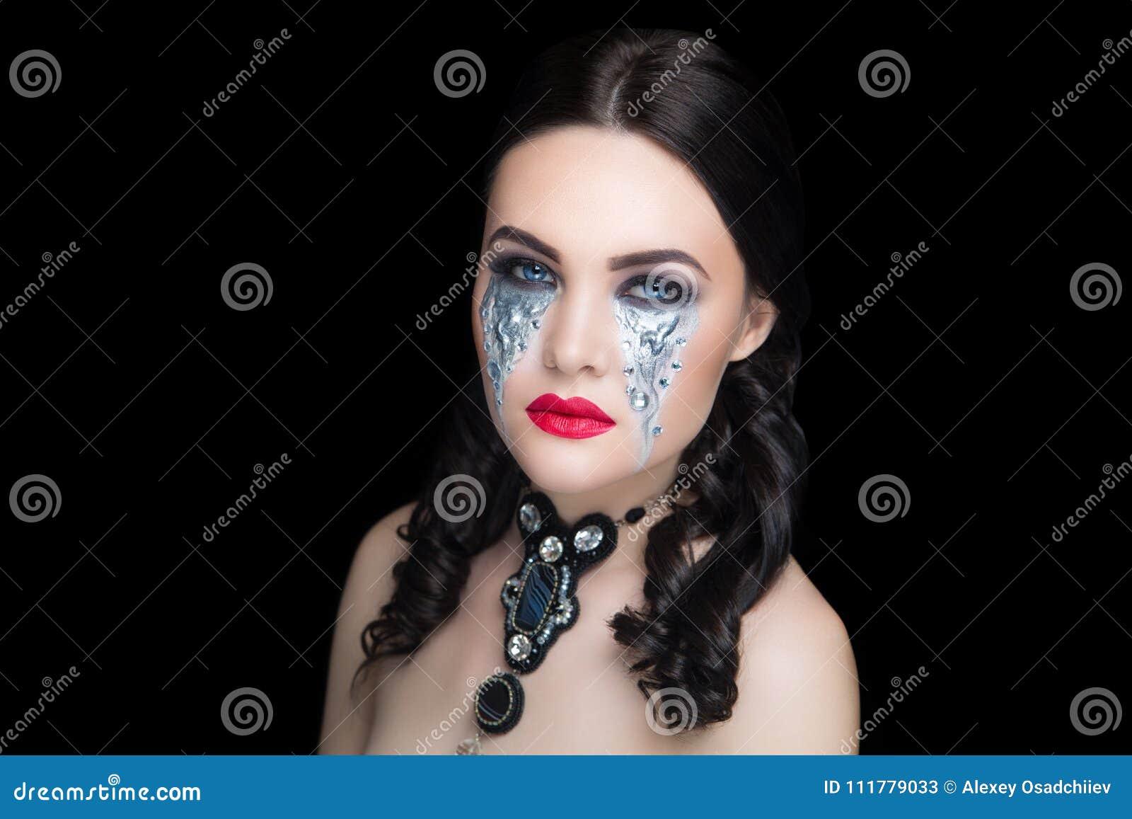 Woman art make up silver tears