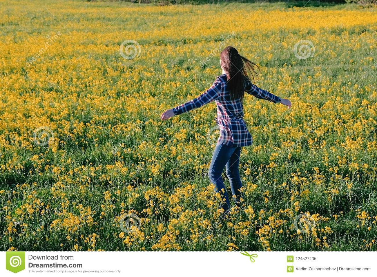 Woman Brunette Walks On The Field Of Yellow Flowers Stretches And