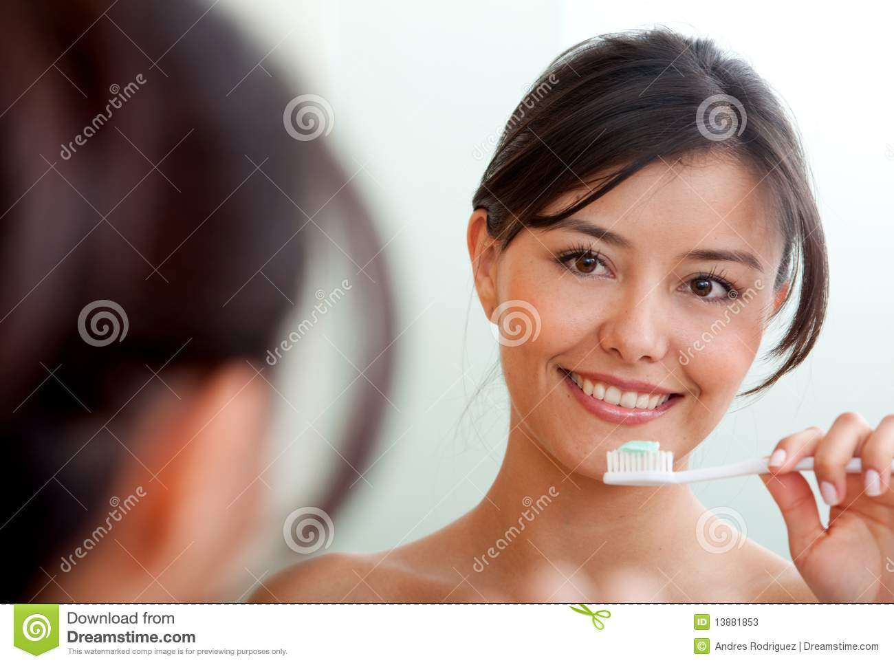 Woman Brushing Her Teeth Stock Photos - Image: 13881853