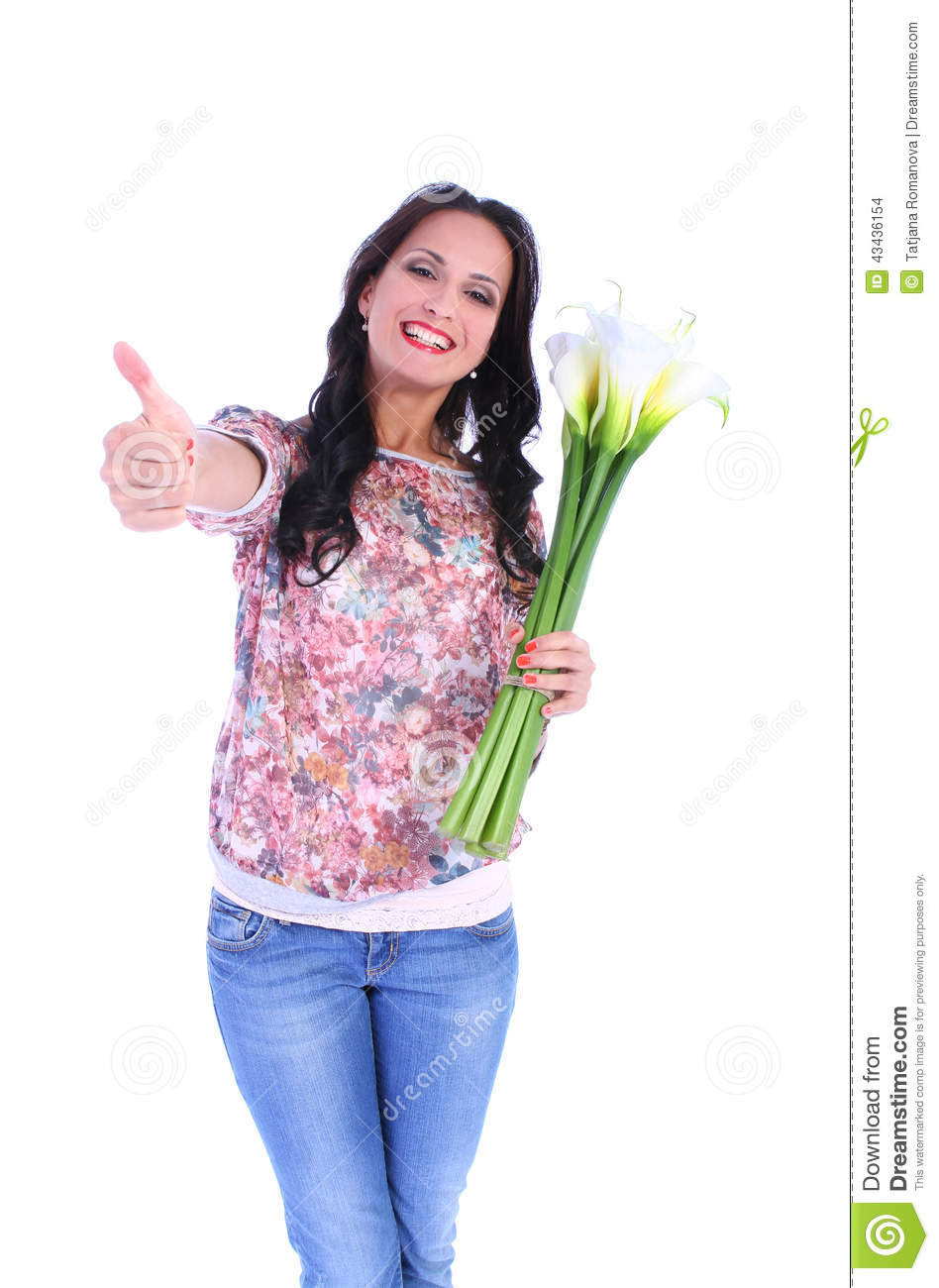Woman with bunch of flowers showing thumb