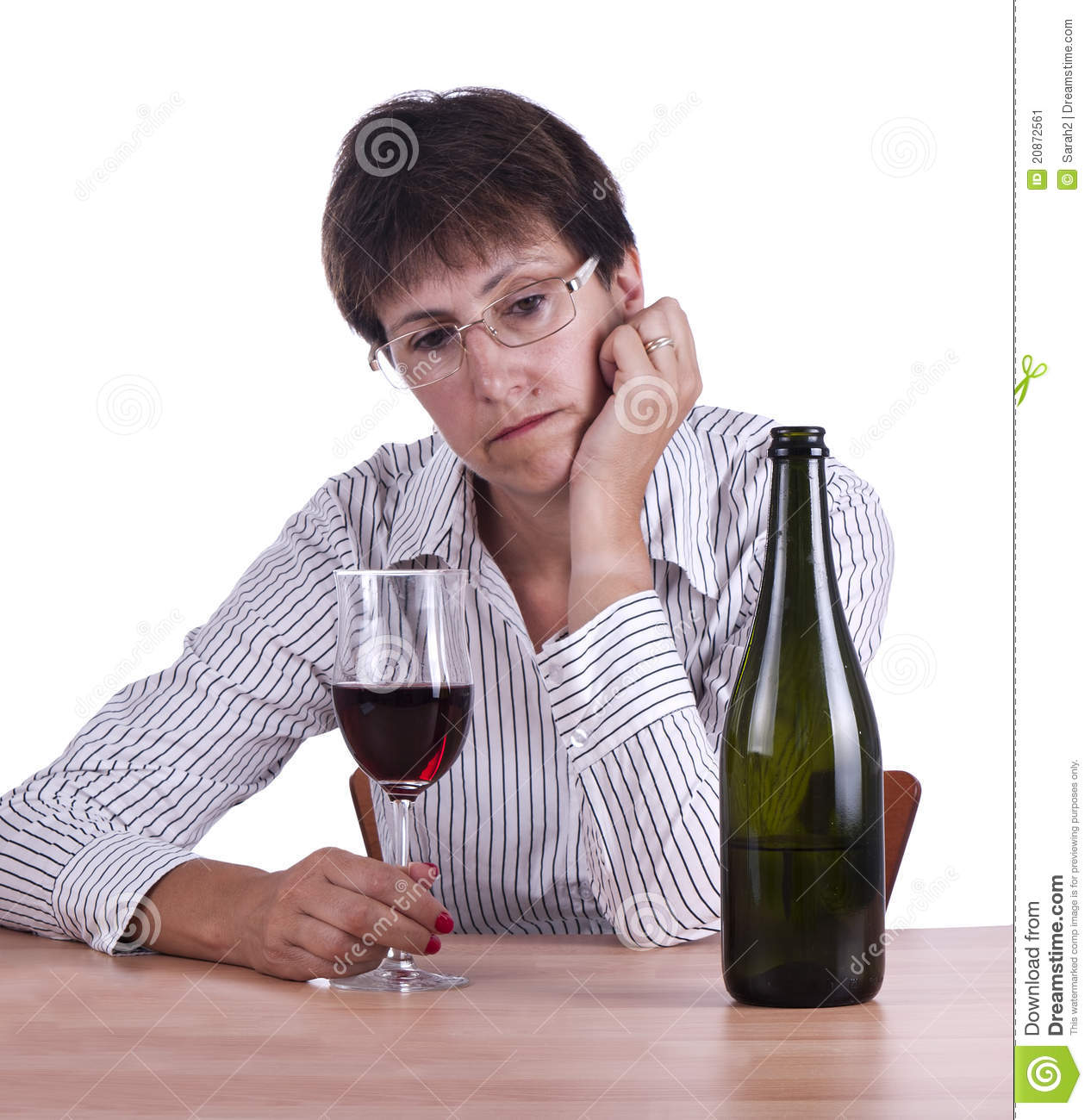 Woman in business shirt drinking red wine alone