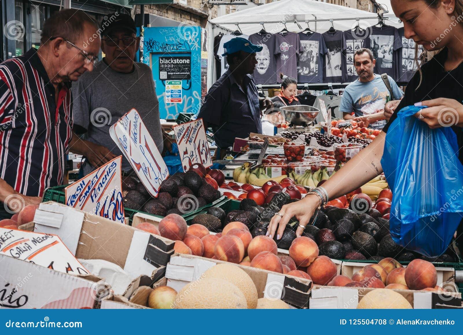feb186c865 Woman Buying Fresh Fruits In Brick Lane